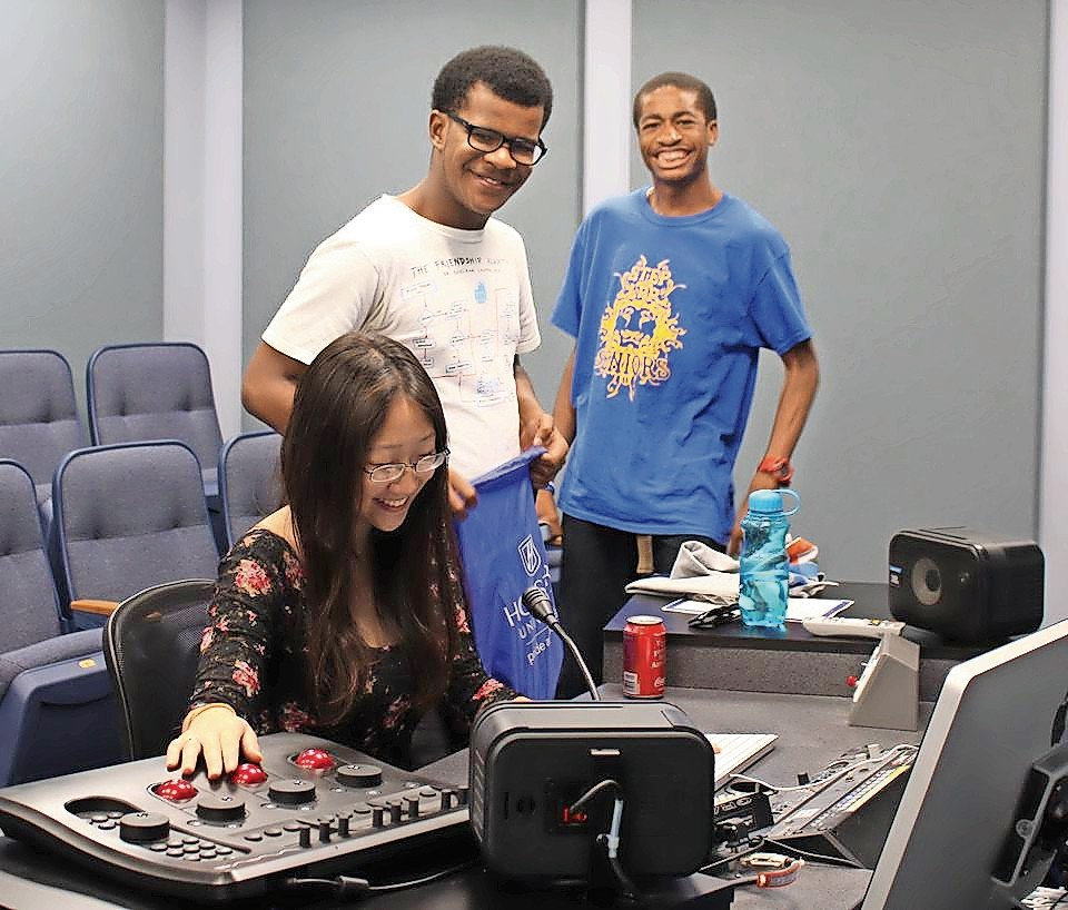 Jayne Chen, from left, Michael Bailey and Nsikak Ekong were among the 10 participants in Hofstra University's recent High School Summer Journalism Institute. Together, they put final touches on the news stories that had to write for the program.