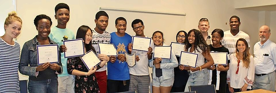 Hofstra Summer Institute students received Hofstra University Certificates of Merit for their participation in the program. Above were, from left, program mentor Courtney McGee, participants Mikelley Baptiste, Rex Asabor, Jayne Chen, Rodney Legrand, Nsikak Ekong, Michael Bailey, Esly Rodriguez, Fatima Bhutta and Karyse Gocoul, Professor Scott Brinton, participant Amoy Brown, mentors Nakeem Grant, Danielle Agoglia and Professor Peter Goodman.