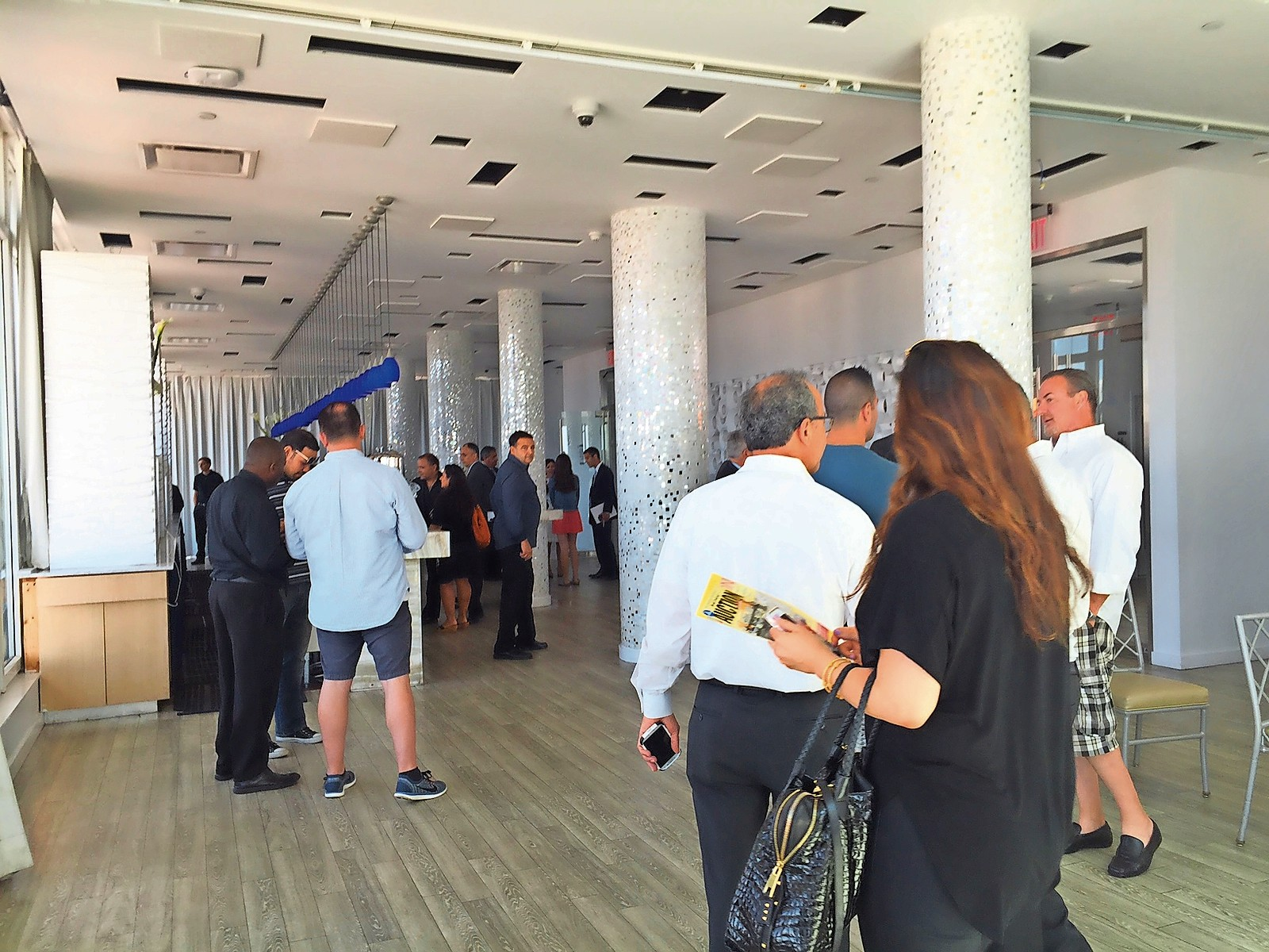The auction, conducted by Central Islip-based Maltz Auctions, took place in the hotel's rooftop lounge and attracted a mix of potential buyers, developers, business owners and local residents. A total of nine bids were submitted.