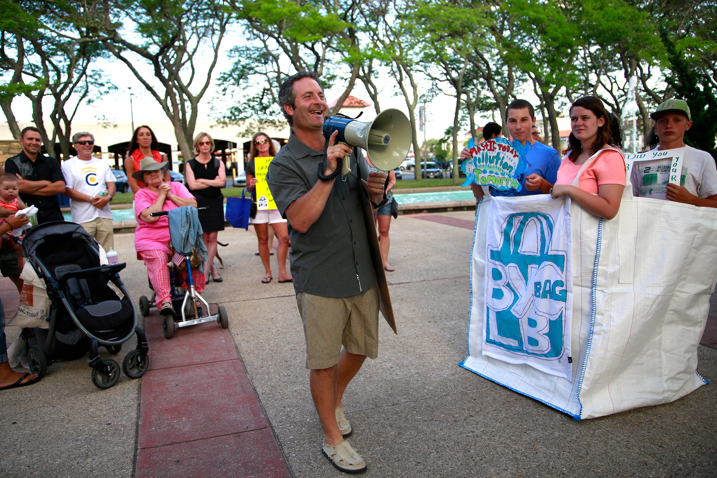 George Povall, of All Our Energy, led the rally, which called for a city ban of single-use plastic bags.
