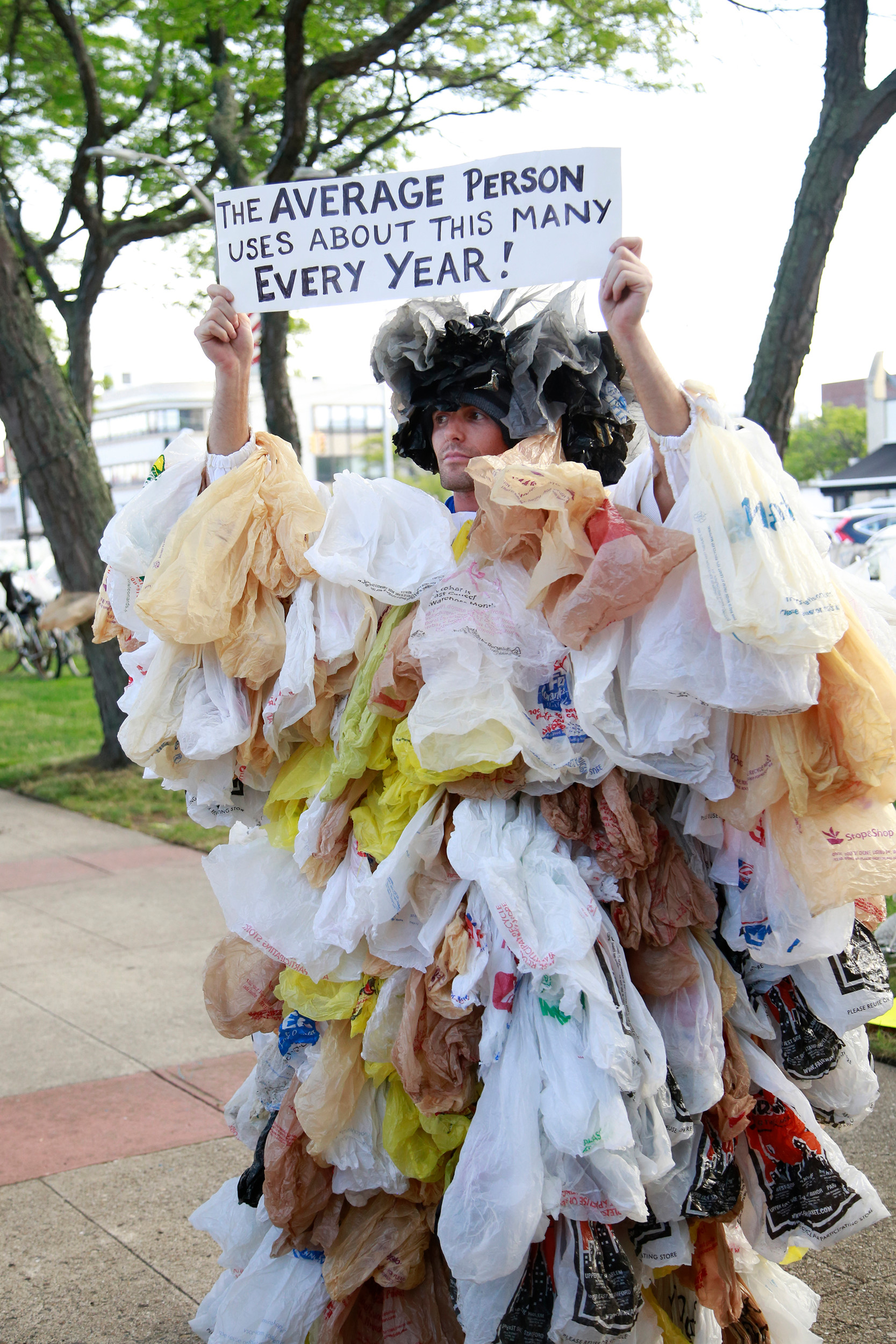 Long Beach resident Joseph Naham stuck hundreds of plastic bags to his body to show how many bags the average person uses in a year.