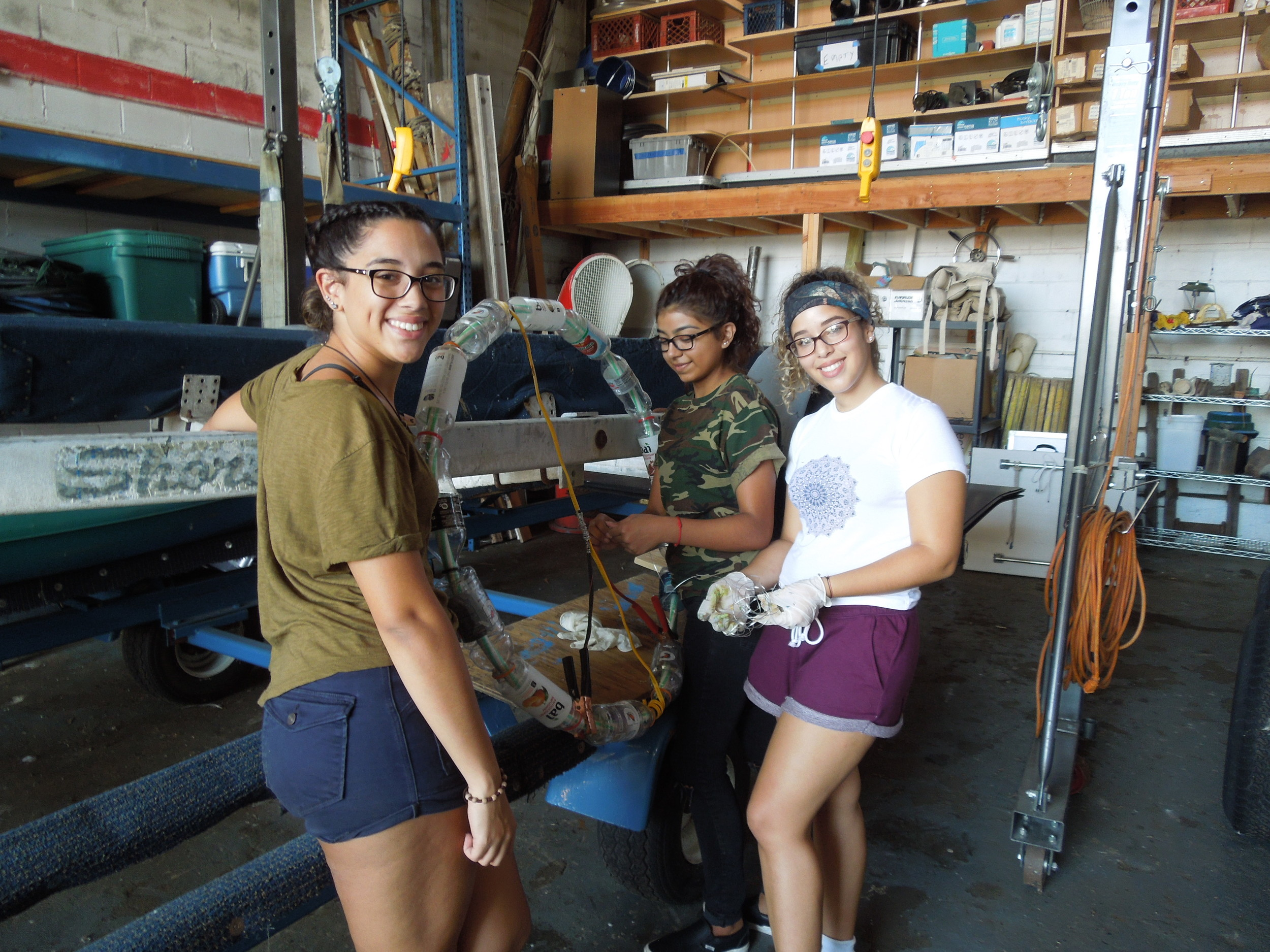 Students work on peace sign. From left Kaitlyn Adames, Jennifer Orantes and Kimberly Adames.