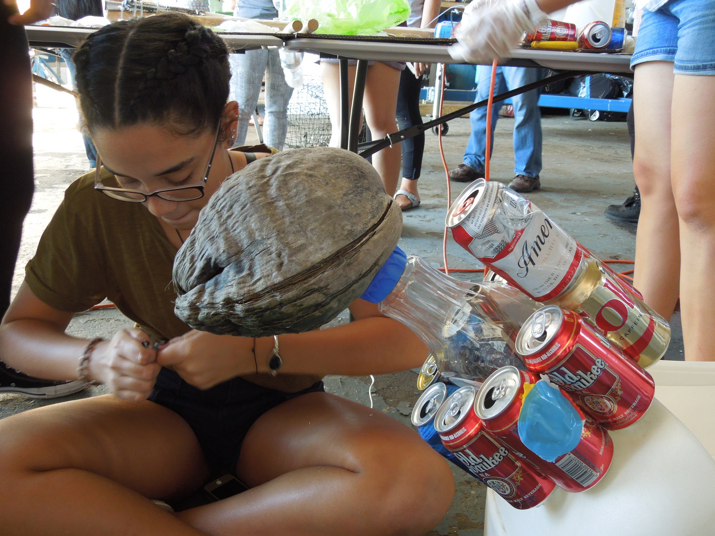 Kaitlyn Adames worked on the peace dove. The head is made from a coconut. The cans around the dove's neck represent garbage that marine life eat