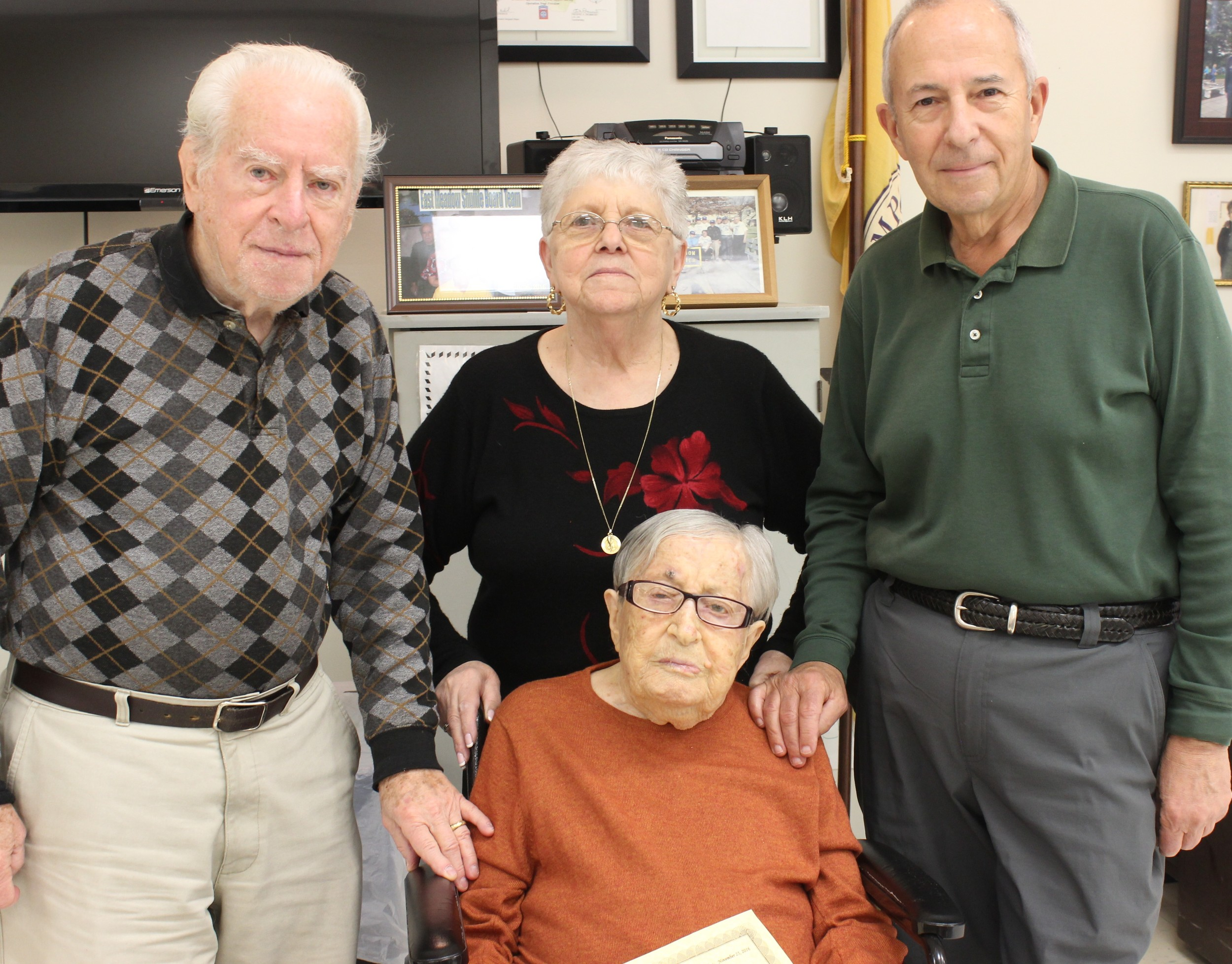 Helping the oldest member of the East Meadow Senior Center, Mollie Spiegel, center, celebrate her 106th birthday were Ray Ronco, Phyllis Caggiano and Burt Spiegel.