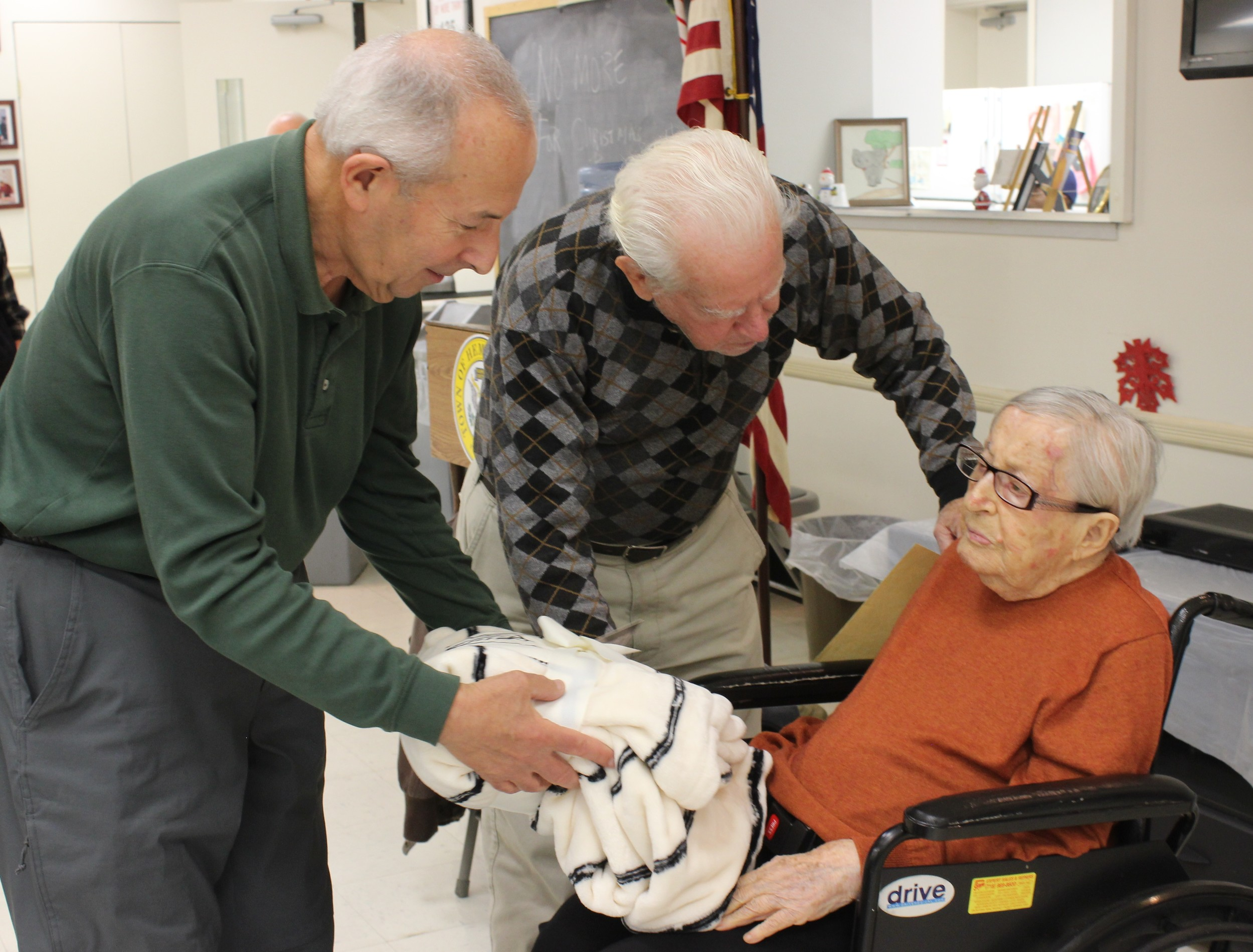 Burt Spiegel and Ray Ronco gifted a soft, white blanket to Mollie Spiegel for her 106th birthday on behalf of the family.