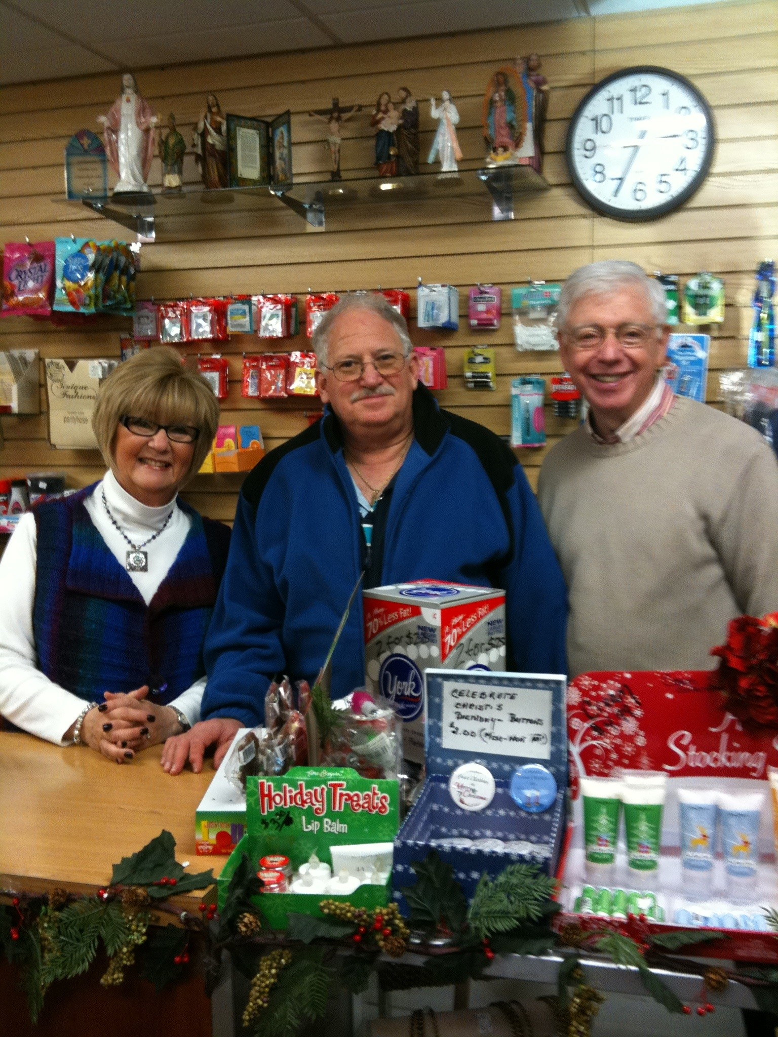 Linda Howard, left, Ira Katz and Barry Howard have volunteered at Mercy Medical Center around Christmas for years.