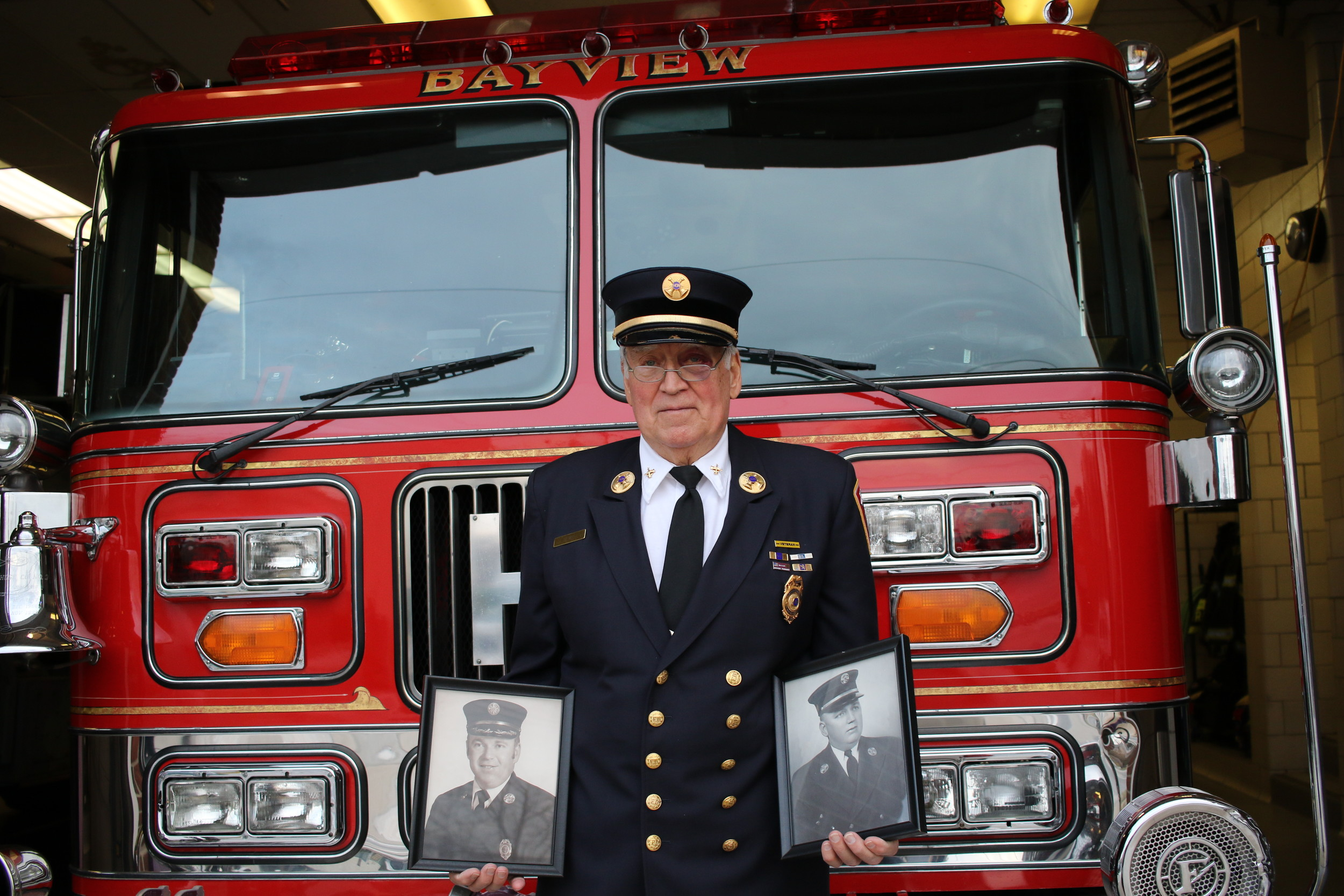 A Family Tradition: Kenneth R Lewis's family have been firefighters in Freeport for 121 years. He is pictured with photographs of his brother Artie and father Kenneth L Lewis who were also Freeport firefighters.