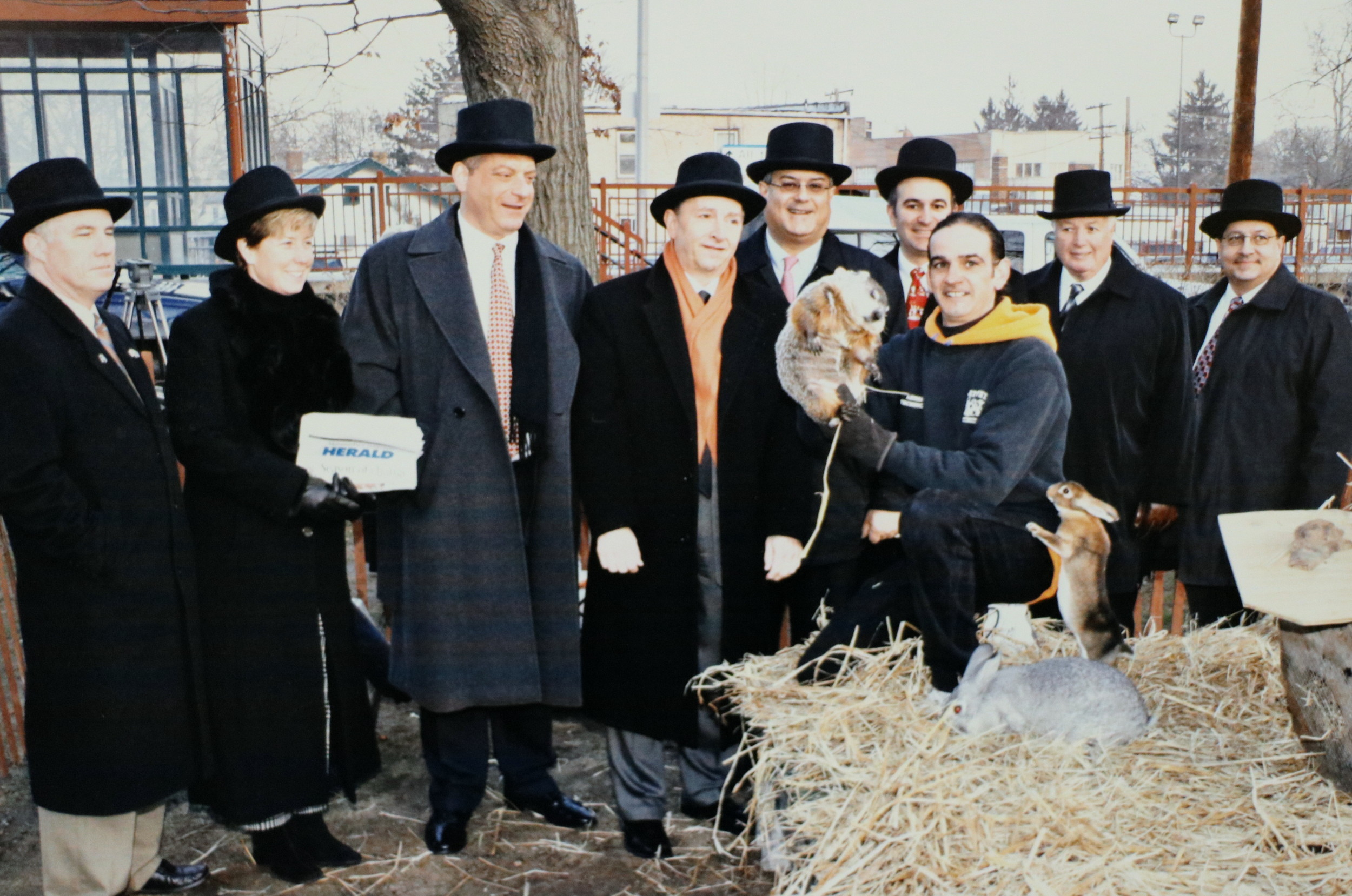Groundhog Day 2004 in Malverne. From left: past village Trustee William Malone; current Mayor Patti Ann McDonald; Herald Publisher Cliff Richner; past Mayor Anthony Panzarella; current Town Supervisor Anthony Santino; past Deputy Mayor James Callahan; Mel handler  Andre Ricaud; past Village Justice James W. Dougherty; and past Lynbrook trustee David Penzo.