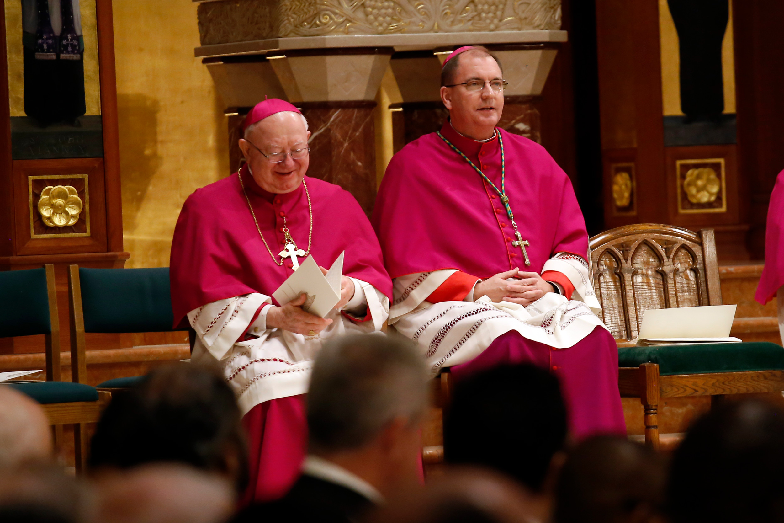 Bishop William Murphy, left, and Bishop John Barres shared the altar at St. Agnes Cathedral in Rockville Centre during a vespers prayer service on Monday night, ahead of Barres's Mass of Installation on Tuesday afternoon.
