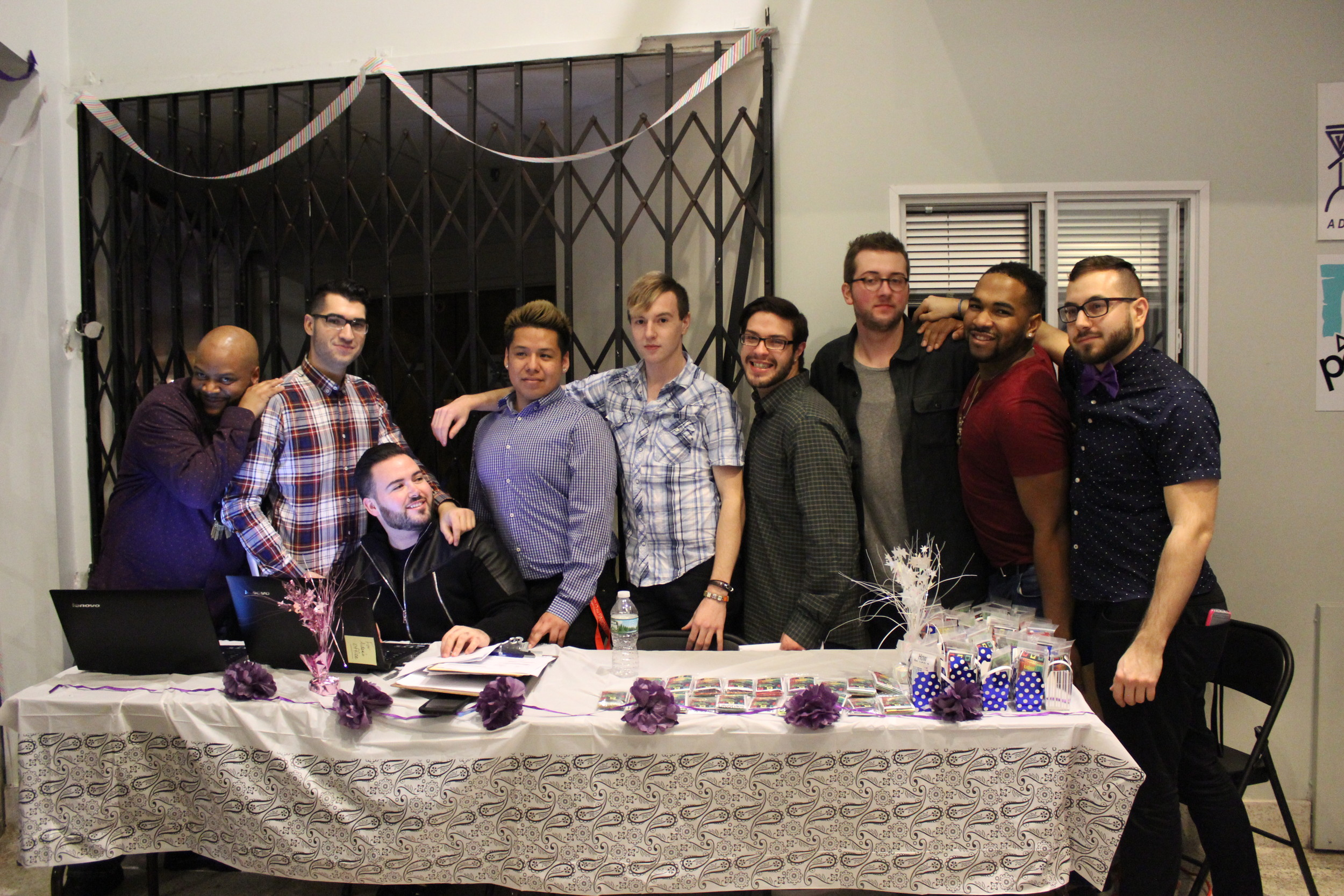 "Members of the Pride for Youth staff celebrated at a launch party for the new app ""Get."" They were Jamie Peeler, left, Nick Dantuano, Aiden Kaplan, Uriel Longman-Gonzalez, Chris Fox, Vinny Maltese, Greg Bonistalli, Eric Thompson and Mario Manaseri."