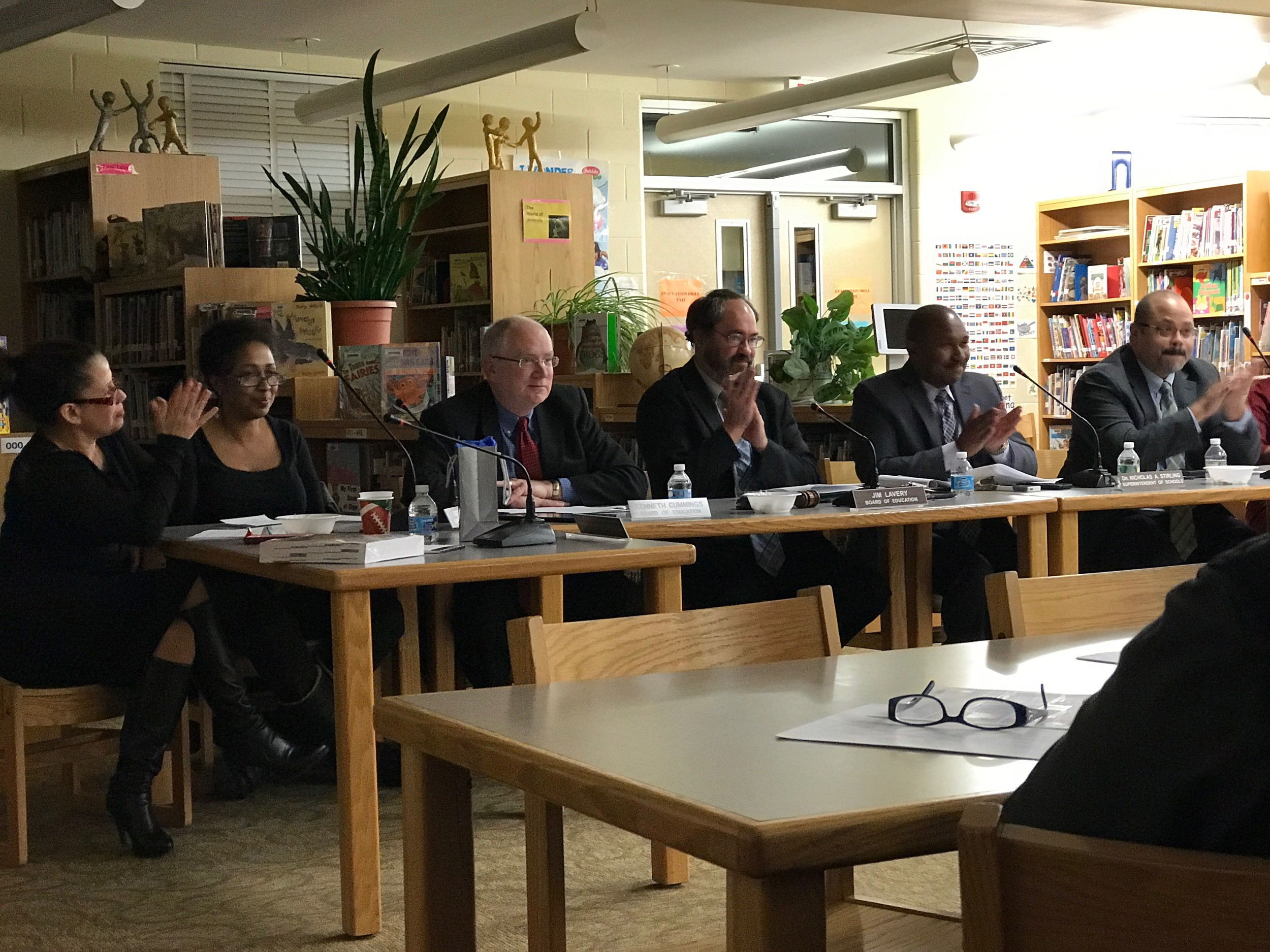 Members of the District 30 Board of Education applauded its vote to add two Islamic holy days to next year's school calendar.