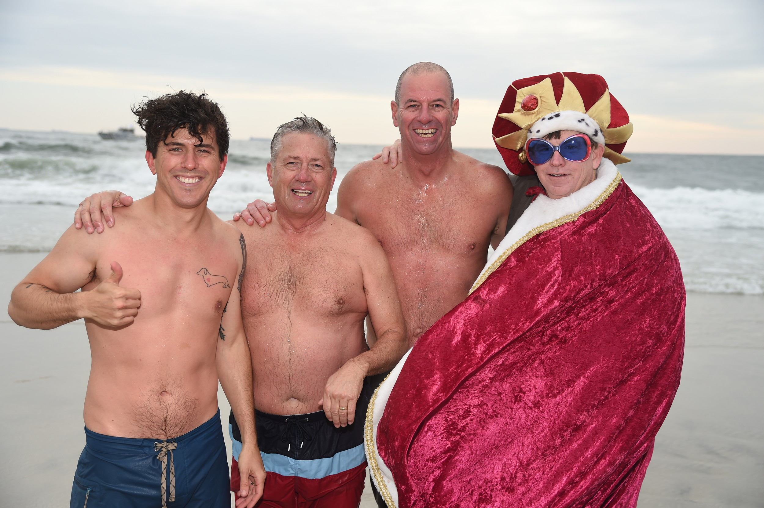 Matt Gordon, of Long Beach, far left, with the co-founders of the Polar Bear Splash Kevin McCarthy and Pete Meyers, and the creatively costumed Pat Gordon.