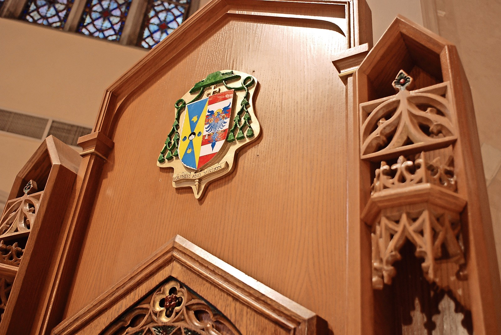 Bishops have coats of arms. Above is the coat of arms of Bishop John Barres, spiritual leader of the Diocese of Rockville Centre.