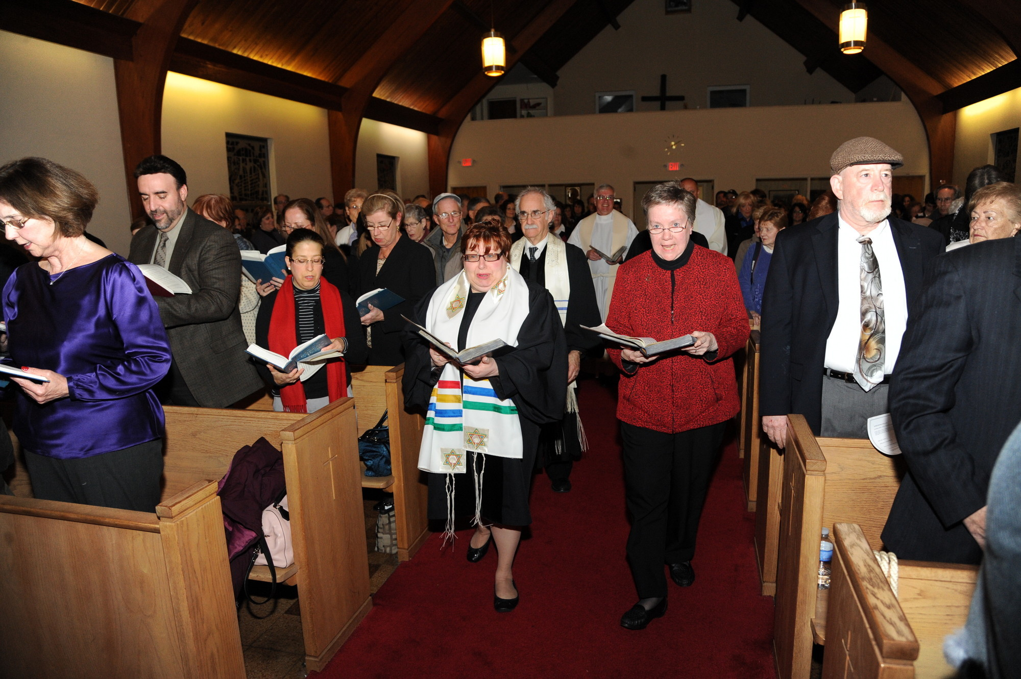 An interfaith service led by Rabbi Judith Cohen-Rosenberg of the Community Reform Temple, left, and Sister Judy of St. Raphael's Roman Catholic Church, in 2013.