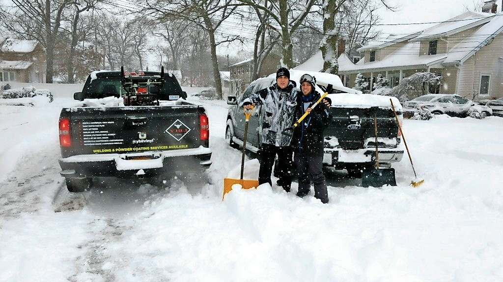 Kyle Baxter, left, and Dan Lombardo, who formed Two Brothers Snow Removal two years ago, helped clear snow from more than 50 houses on Feb. 9 and 10.