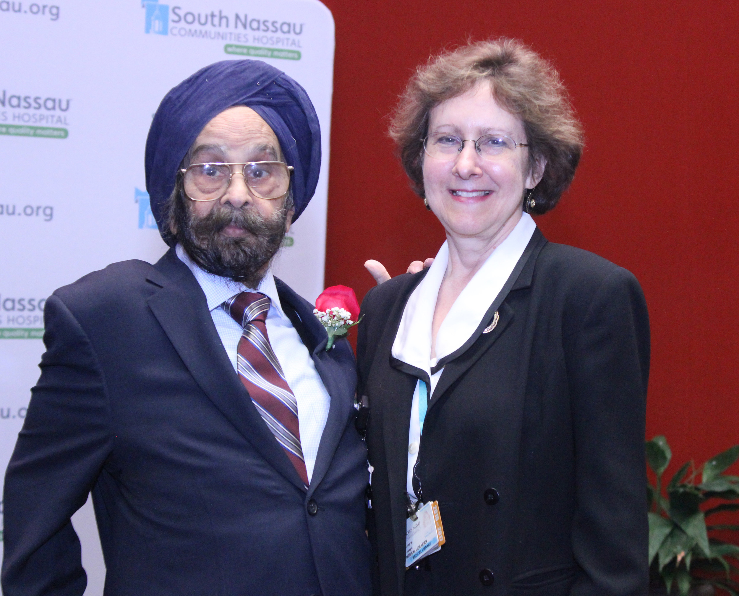 Medical Library director Claire Joseph, right, helped Singh celebrate the renaming of the room in his honor.