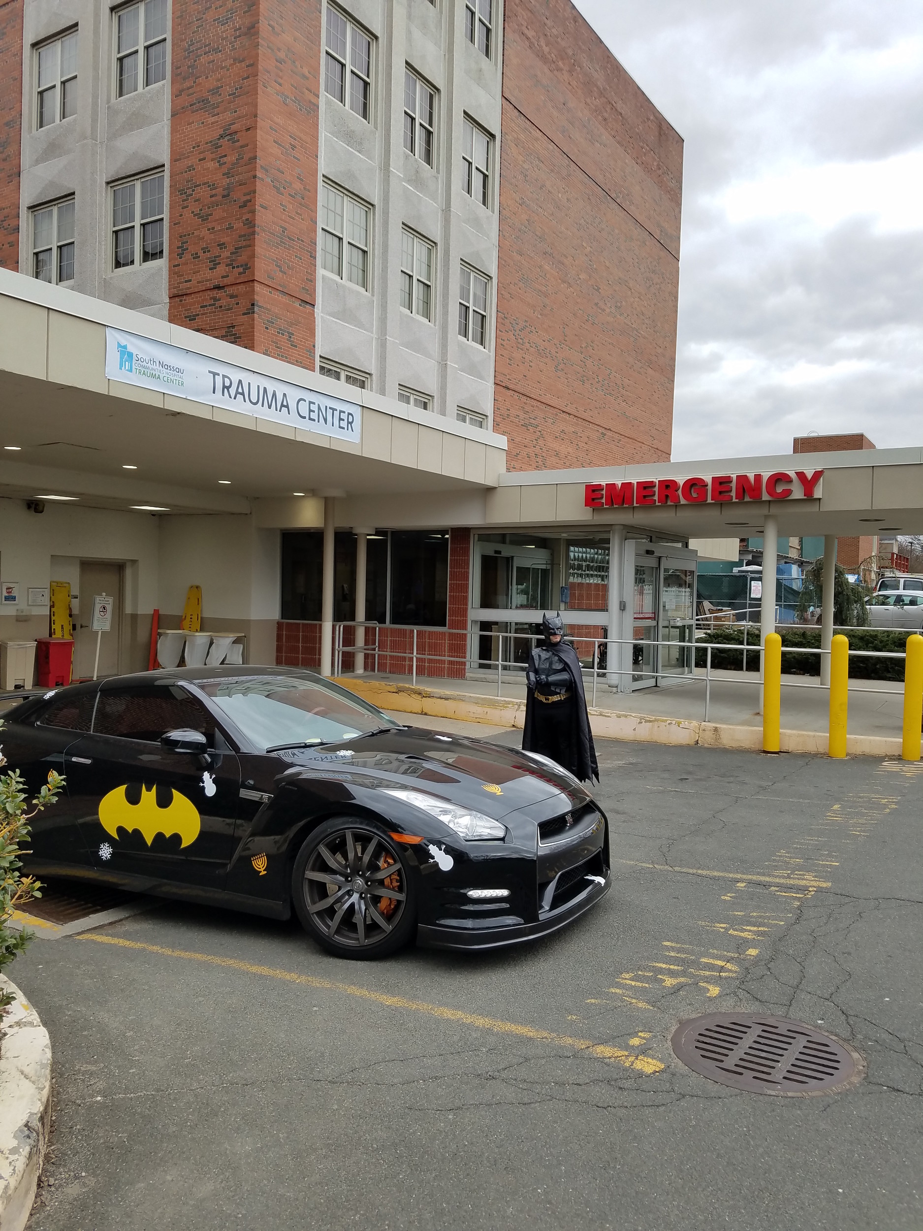 Batman, a.k.a. Josh Aryeh, outside South Nassau Communities Hospital in Oceanside, where he visited an ailing child.