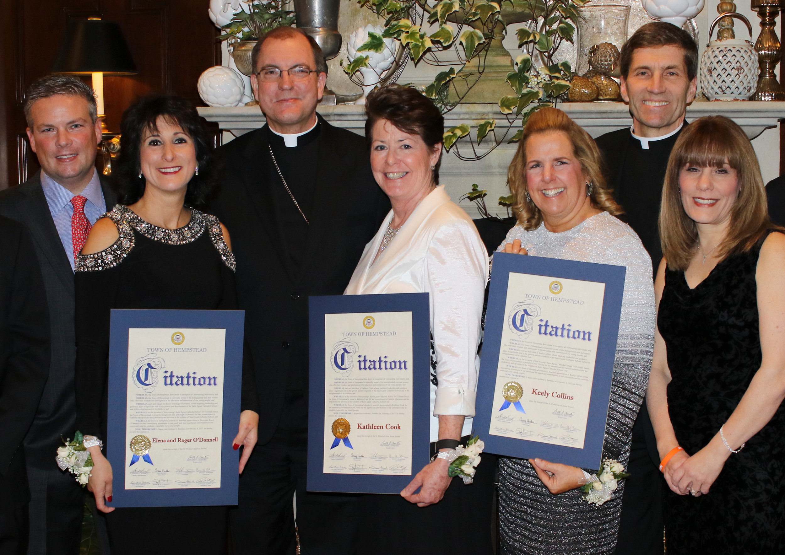 Roger and Elena O'Donnell, left, Kathleen Cook, center, and Keely Collins, third from right, were all honored at the St. Agnes Dinner Dance on Feb. 4. Bishop John Barres, third form left, Monsignor William Koenig, second from right, and St. Anges School principal Cecilia St. John, right, were also in attendance.