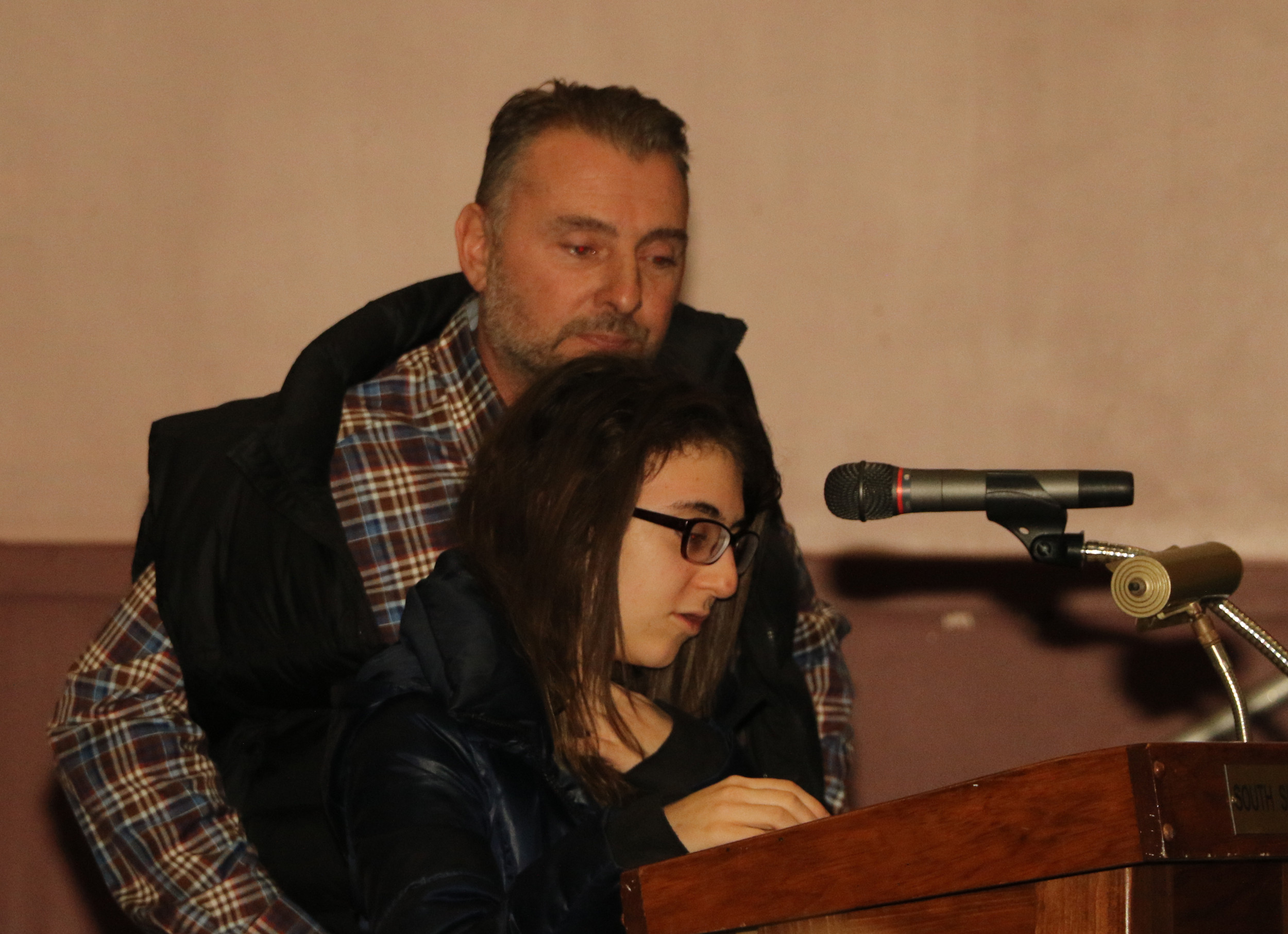 Ava Corbett, 14, of Plainview, with her father, Tim. She spoke of the difficulties she was facing in high school and the toll they were taking on her.