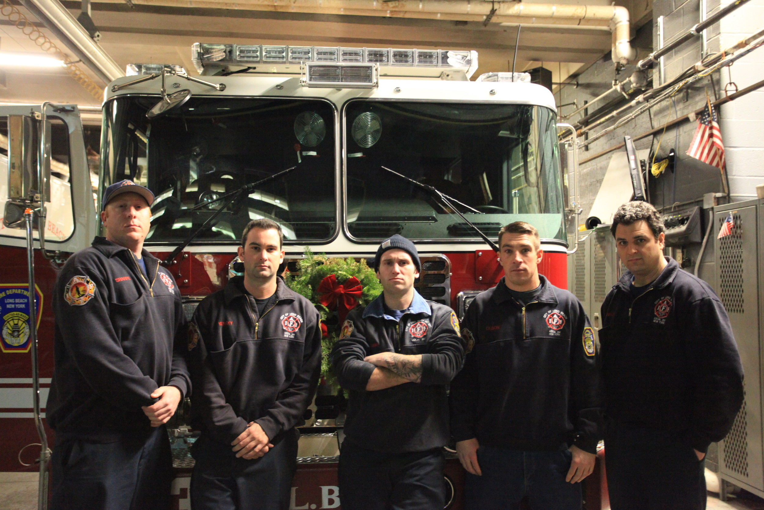 Former Long Beach firefighters Alex Sharpe, far left, Dave Yolinsky, Greg Kavazanjian, Brian Olson, and John Innella in 2014. All but Sharpe, who resigned to join the Nassau County Police Department, received separation notices in 2015.