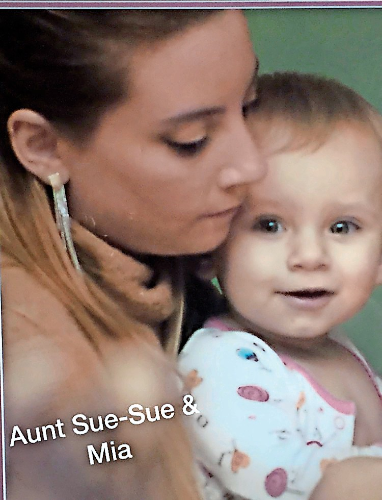 Susan Ambrosino was murdered on Feb. 24, 2005, because her boyfriend at the time didn't want her to keep their baby. Here, Ambrosino held Mia Clark, her niece, who is collecting diapers for charity in her memory.