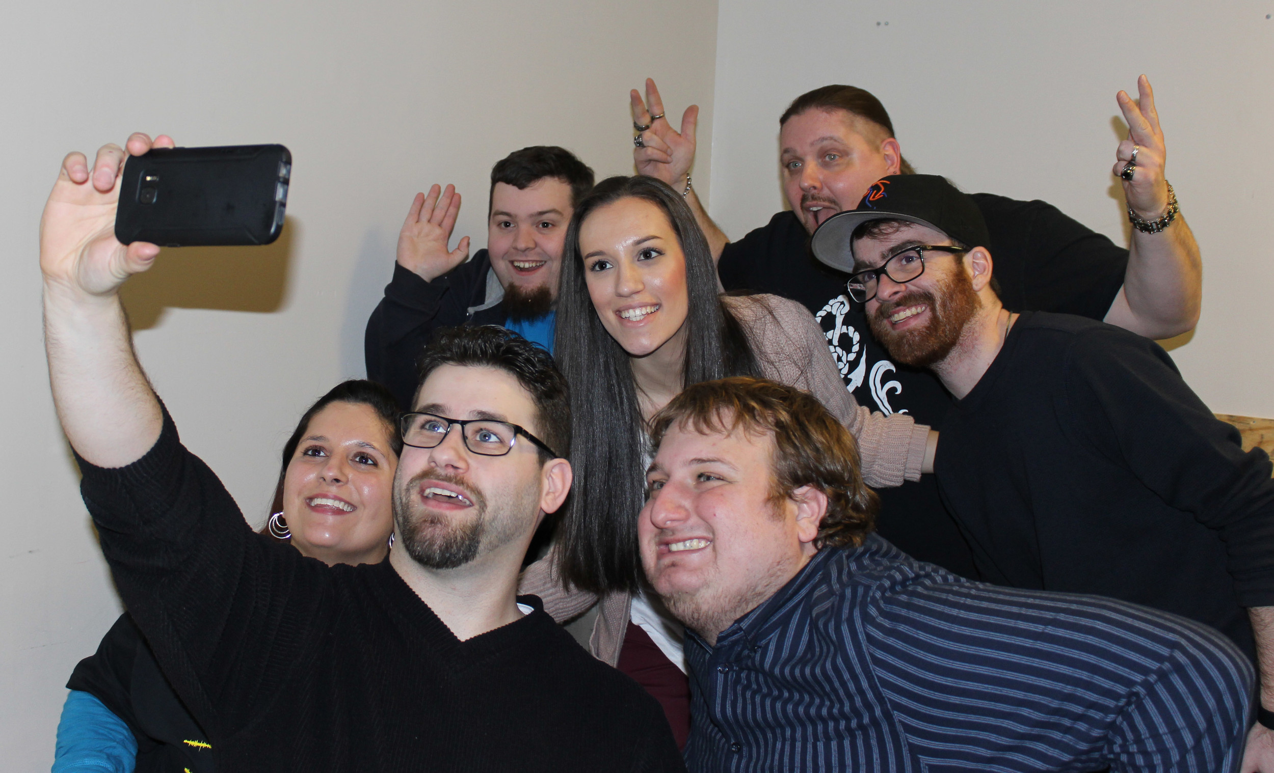 Grindhouse Radio cast members and friends, posing for a group selfie, included Jenna Leonardi, far left; co-host Stephen Zambito, 25, of Stony Brook; Kevin Dempsey, 26, of Bay Shore; co-host Kim Adragna, 22, of Merrick; Steve Eisenberg; co-host William Kucmierowski, 42, of Levittown; and Tom Greer, of West Babylon.