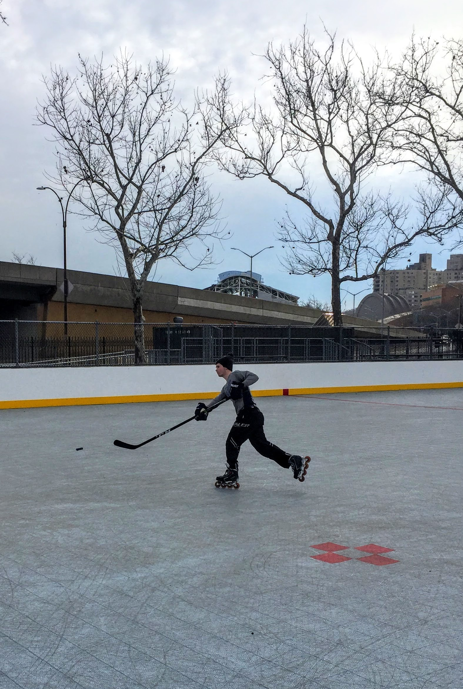 Jesse Gordon, mid shot, on a rink in northern Manhattan.