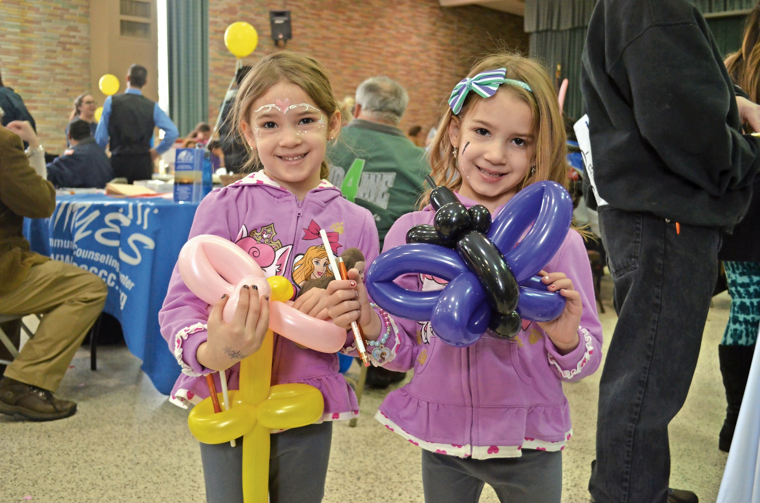 Julianna Duarte, left, and Gabriella Duarte made balloon animals for each other.