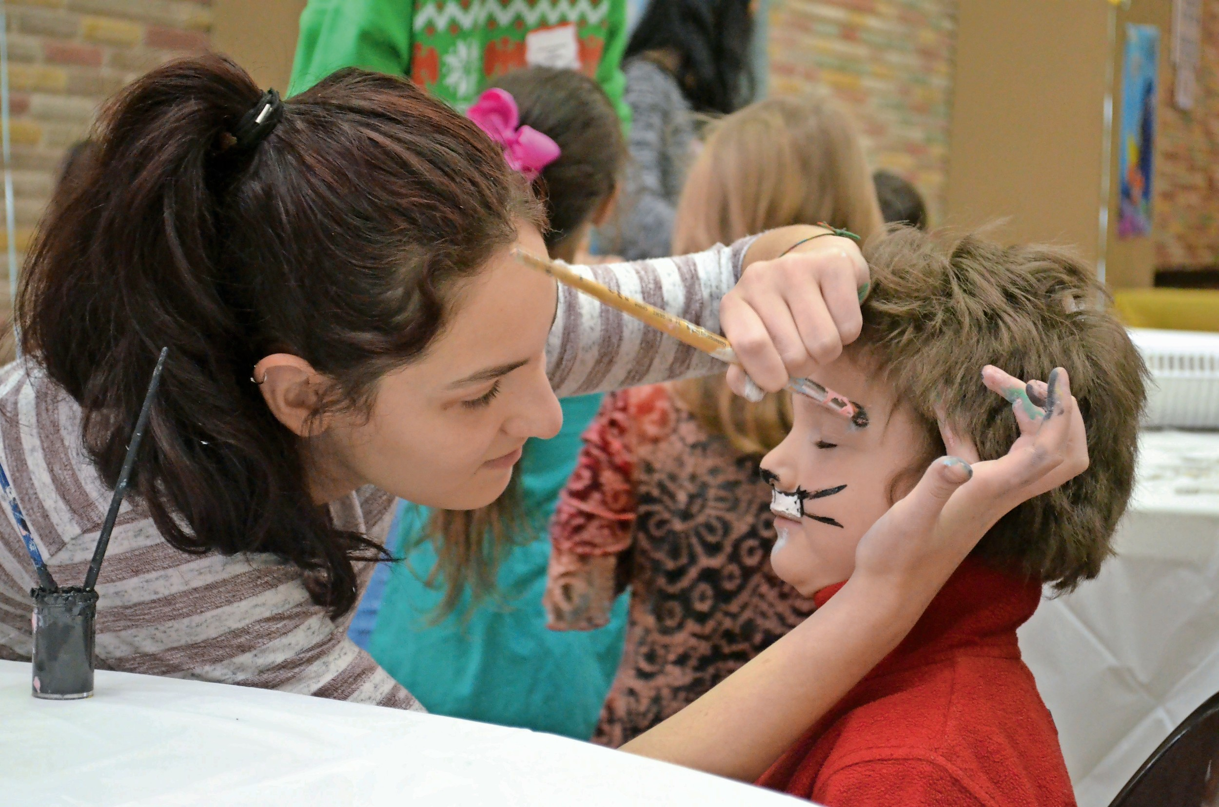 Efe Koc, 4, had his face painted as a tiger for the celebration.