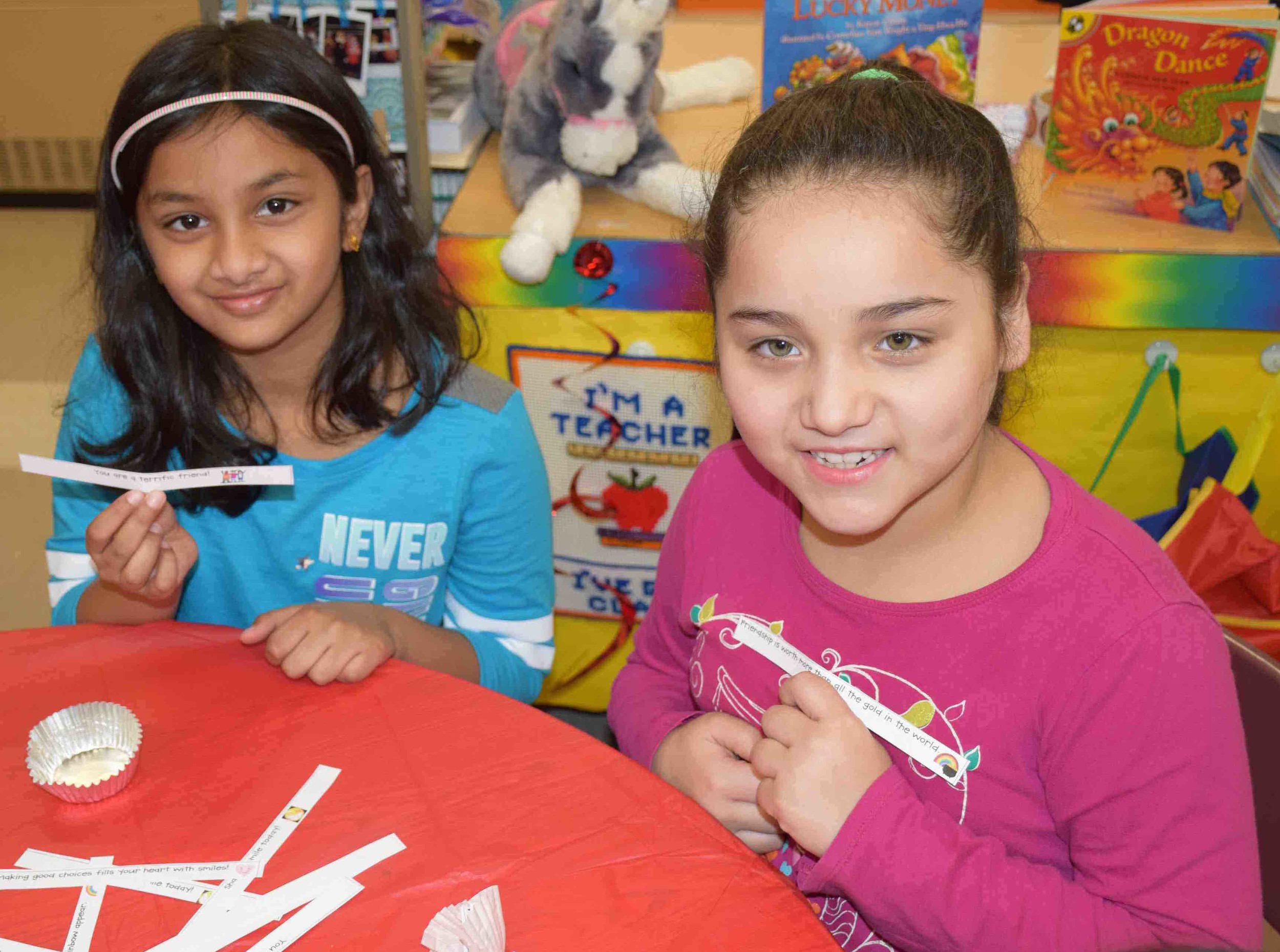 Meadowbrook Elementary School second-graders Liana Boby and Stephanie Hunyh created red envelopes containing lucky money.