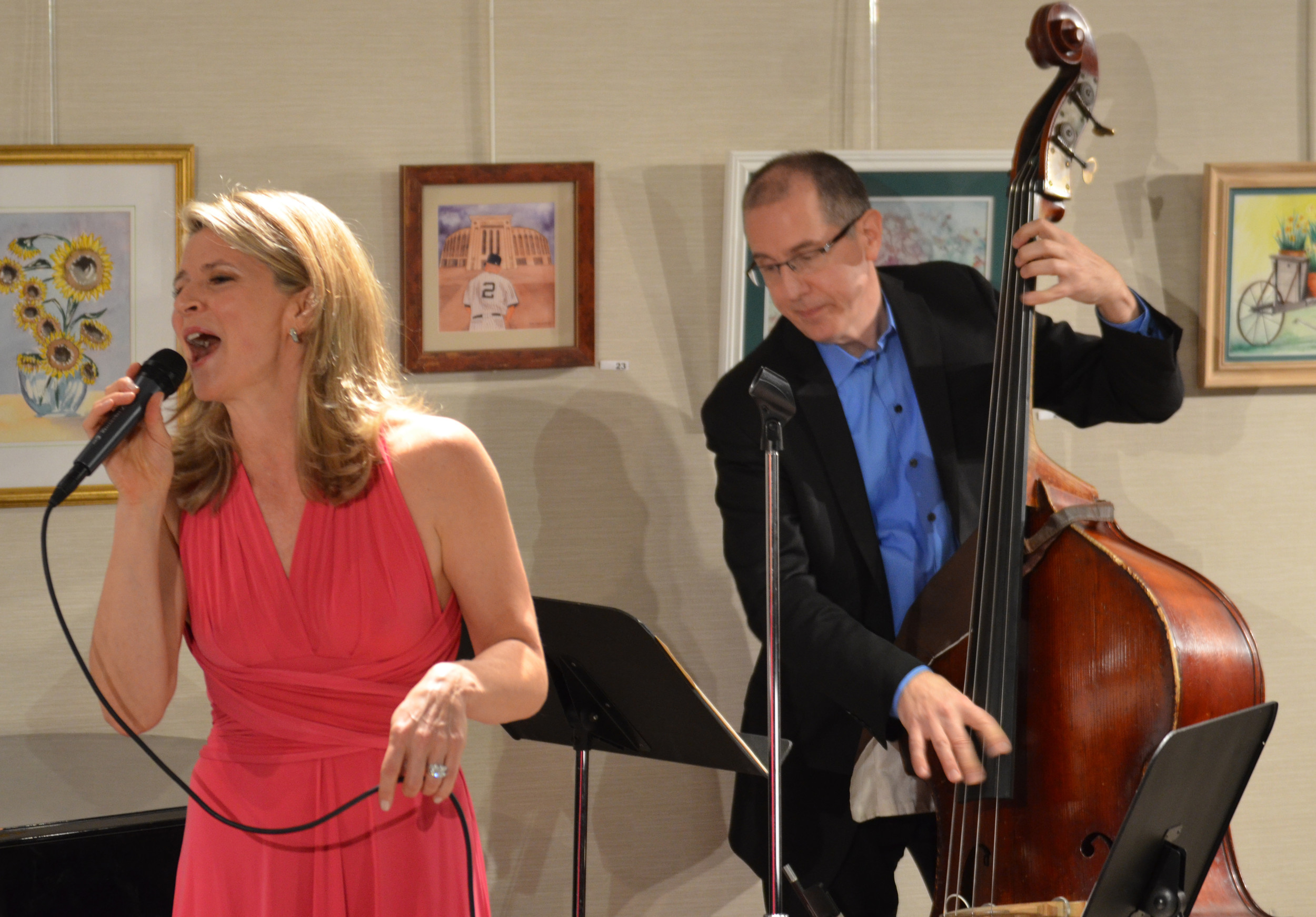 Singer and actress Annie Kozuch sang a collection of songs at the East Meadow Public Library on Feb. 3, with Tom Hubbard on the bass.