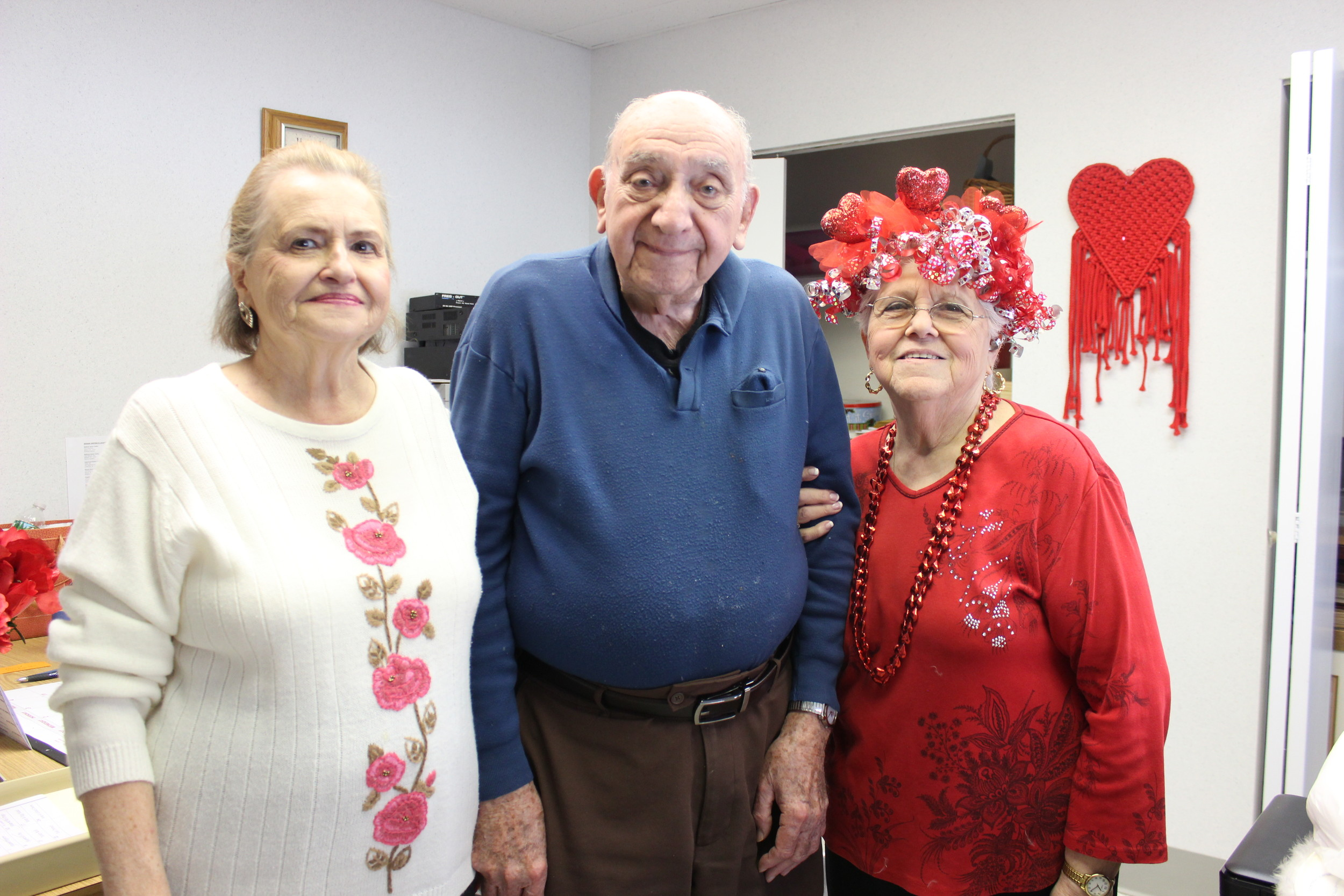 Salisbury Senior Center President Judy Vulpi, far left with Charlie Franza and Phyllis Caggiano, embraced the East Meadow Senior Center members when the centers merged in late December.