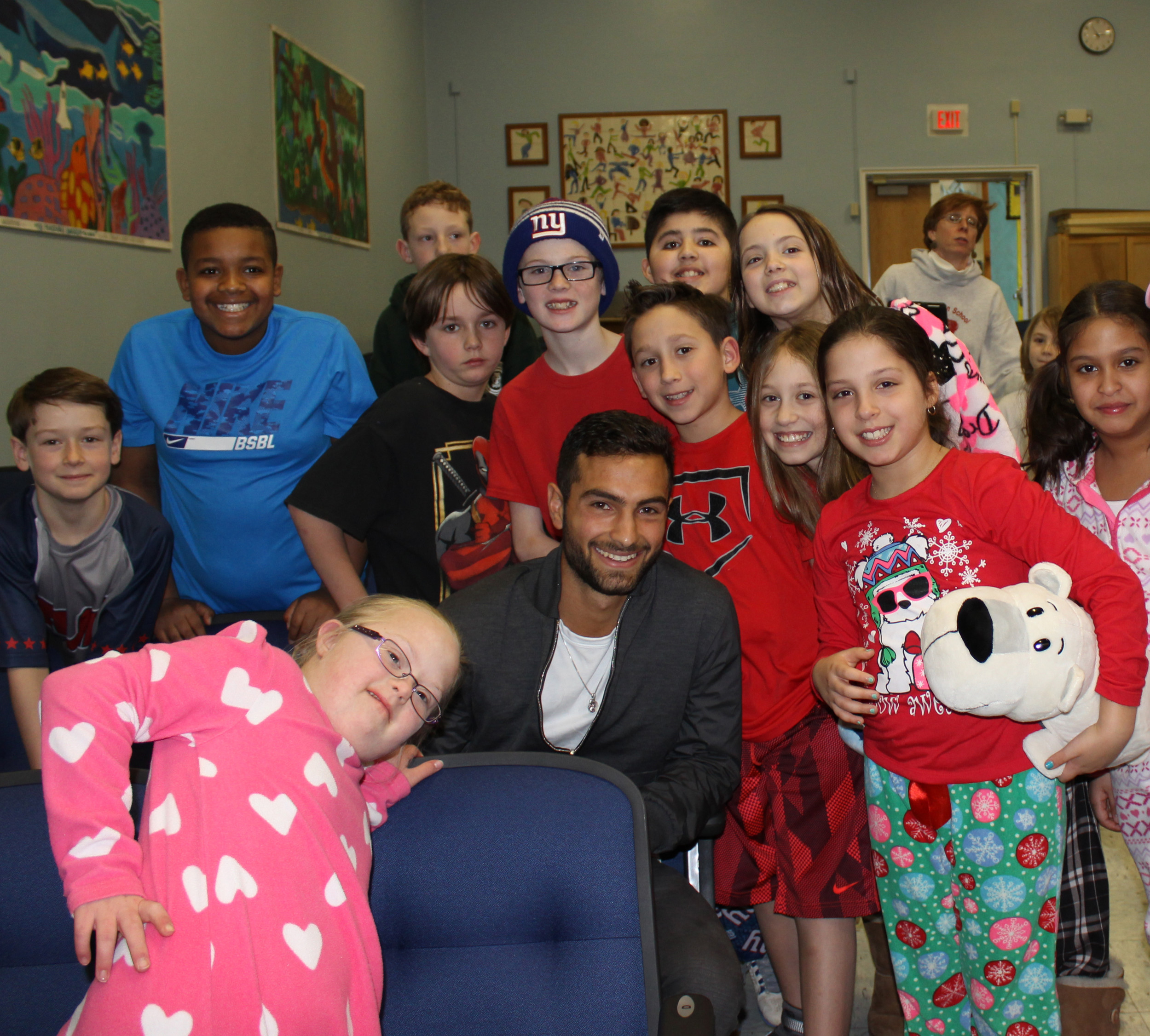 Noah Rubin with fourth- and fifth grade-students at Covert Elementary School in Rockville Centre at their Pajama Day event.
