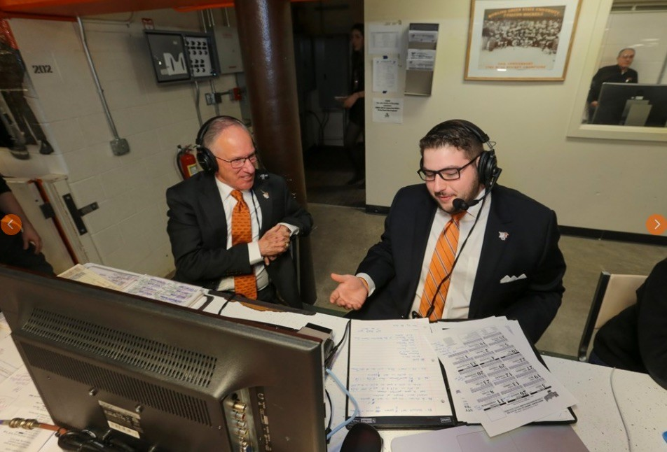 "Evan Pivnick, right, an Oceanside High School graduate and senior at Bowling Green State University, shared the broadcast booth with esteemed commentator Mike ""Doc"" Emrick during a Falcons hockey game on Feb. 11."