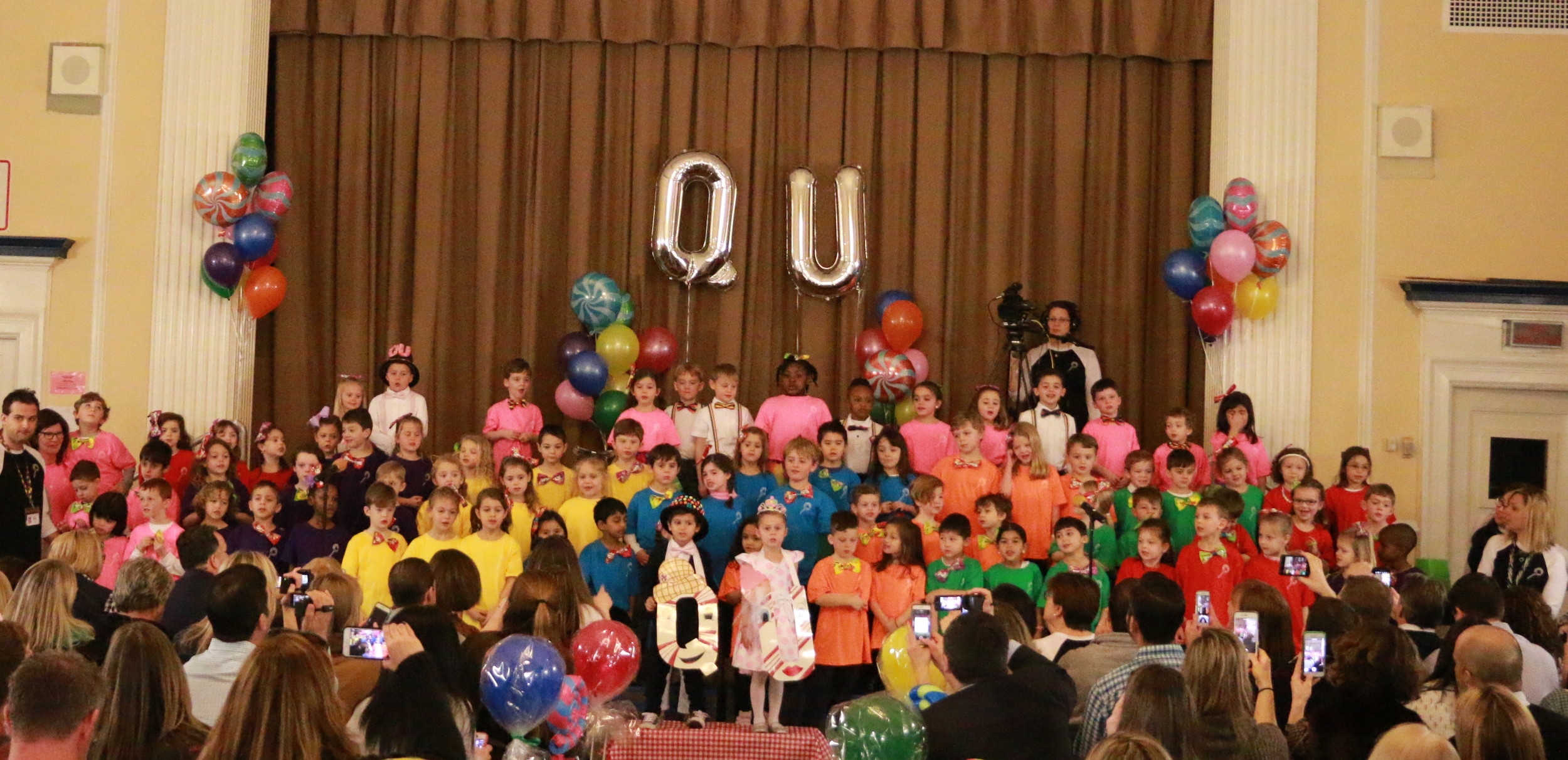 The entire kindergarten class at Jennie E. Hewitt Elementary School gathered in the auditorium for the Q and U wedding on Feb. 17.