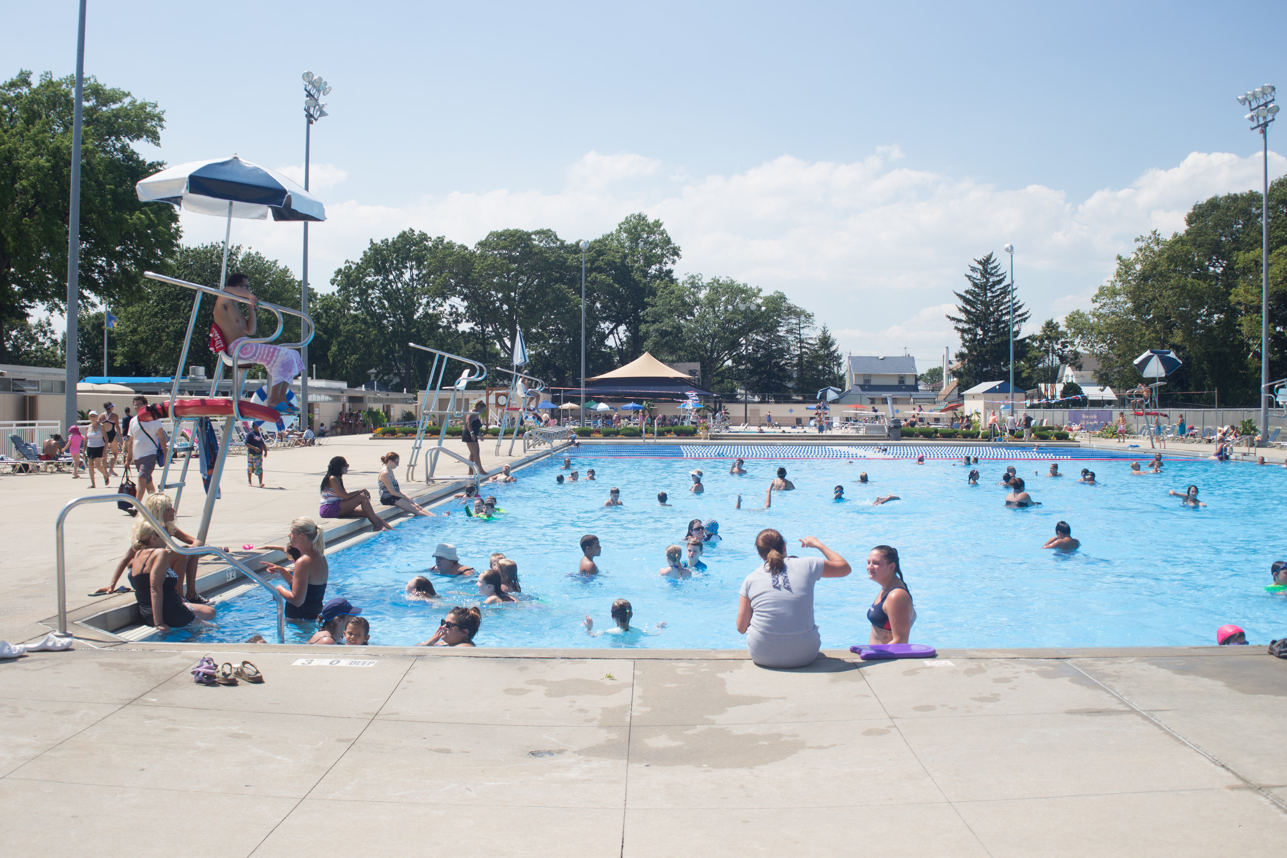 The village pool was packed in August.