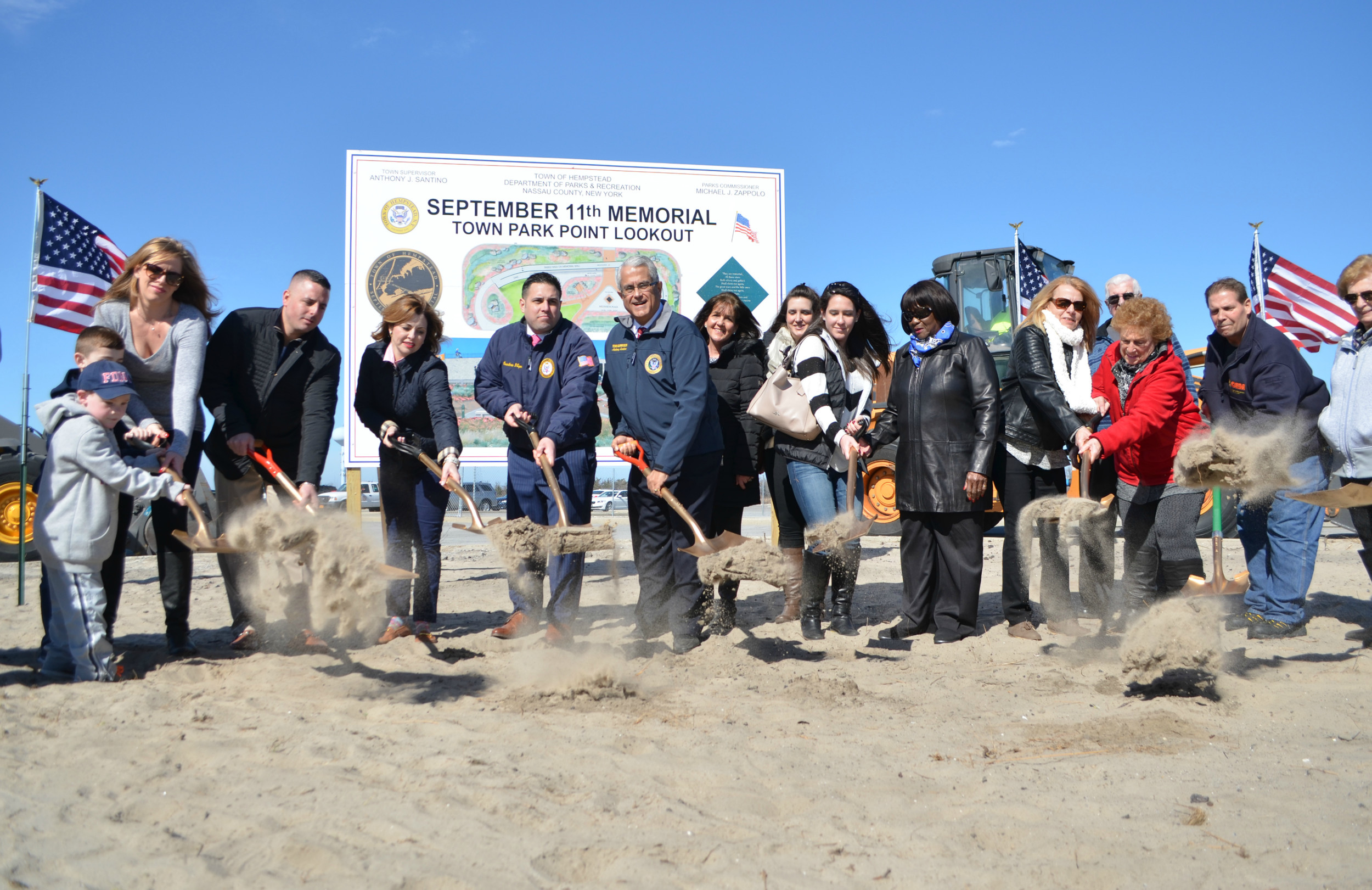 Hempstead Town Supervisor Anthony Santino and council members Dorothy Goosby, Erin King Sweeney and Anthony D'Esposito joined families of 9/11 victims as they broke ground on the site of a permanent memorial at Town Park at Point Lookout on Feb. 24.