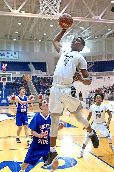 Elmont's K.C. Ndefo slammed down two of his 22 points in last Saturday's Nassau Class A championship game victory over South Side.