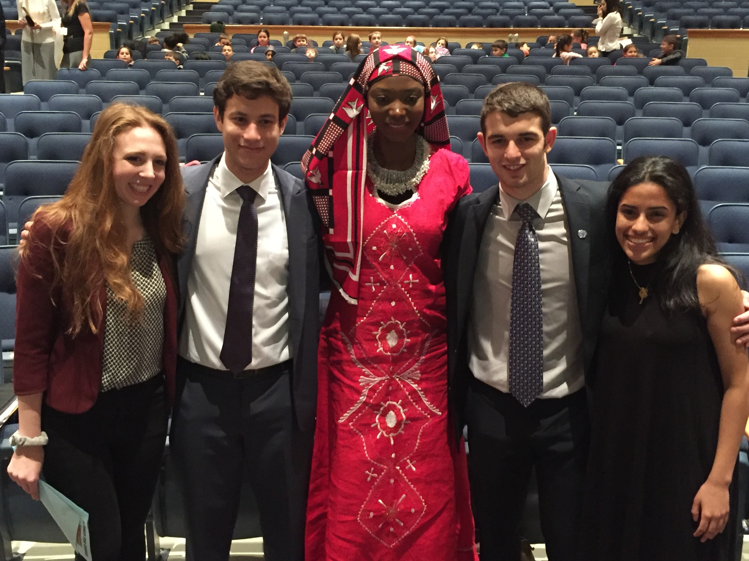 "Oceanside High School's World Interest Club officers Leah Berkman, left, Nathan Gershengorin, Andrew Carlins and Josena Joseph with model and activist Georgie Badiel during the district's ""A Thirst For Change"" event on March 1."