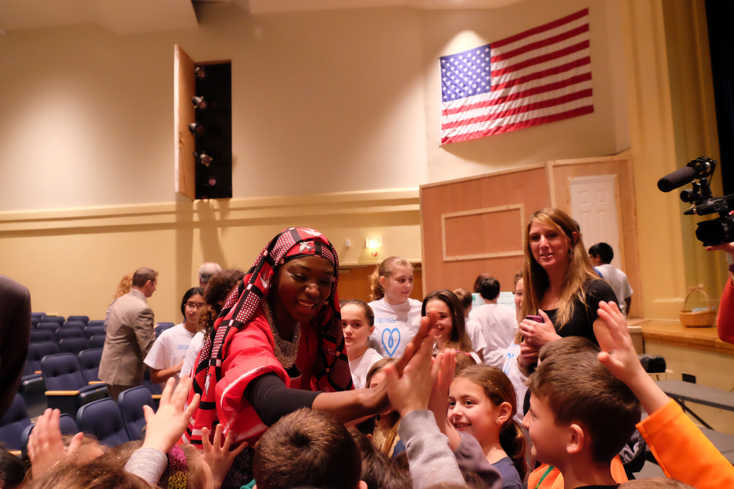 Georgie Badiel high-fived children after they gave a presentation on the lack of access to clean water in her home country of Burkina Faso, and around the world.