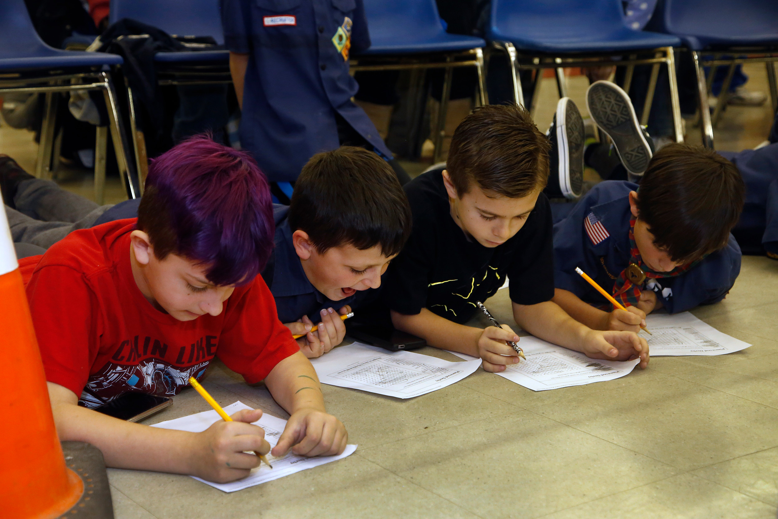 Christian Grillo, Josh Vobis, Adam Lopel and Gavin Horvath worked on their Pinewood Derby word search.