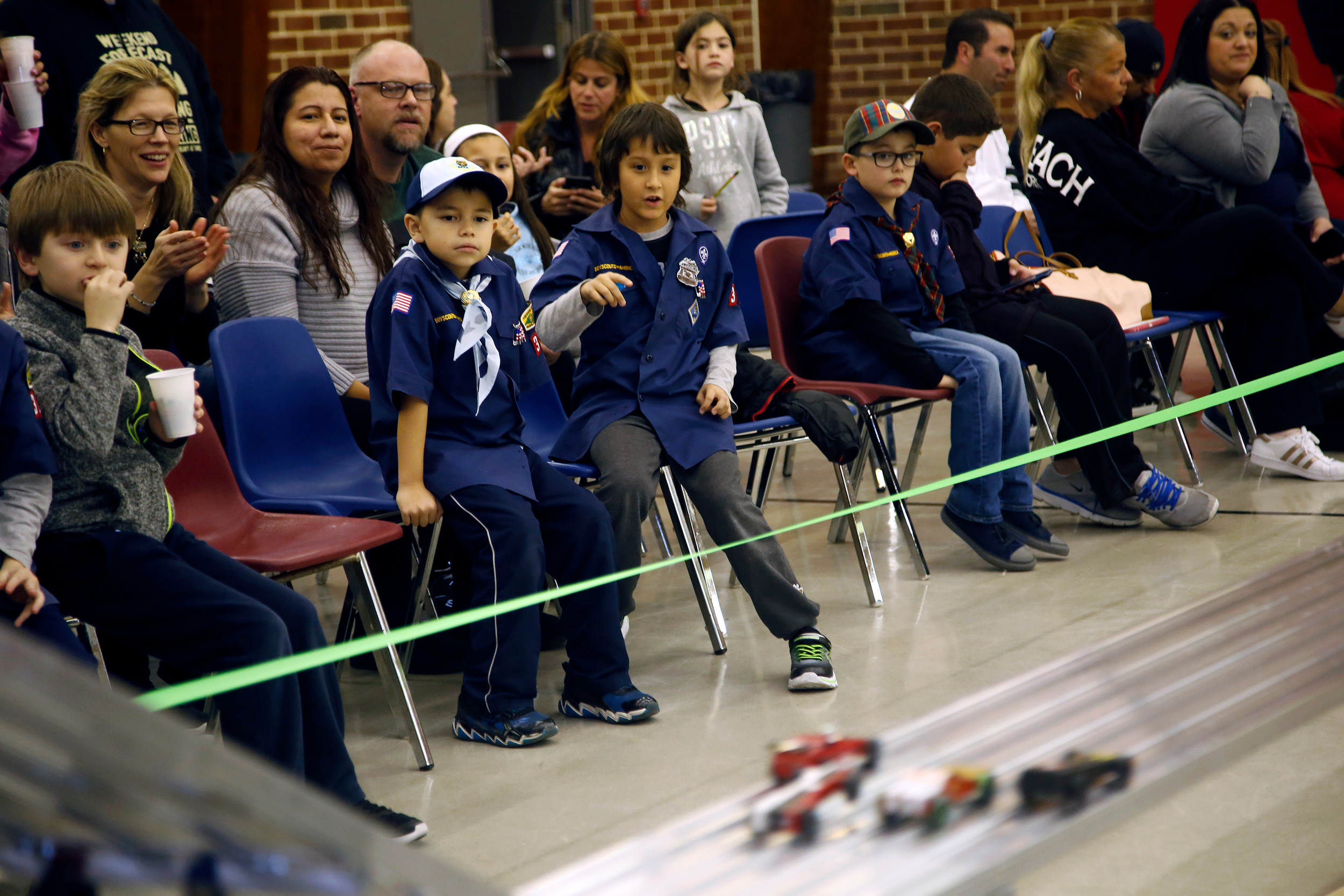 Cub Scouts Aiden Pilch and Vincent Aupied enjoyed a great view of the action during Pack 312's Pinewood Derby on March 3.