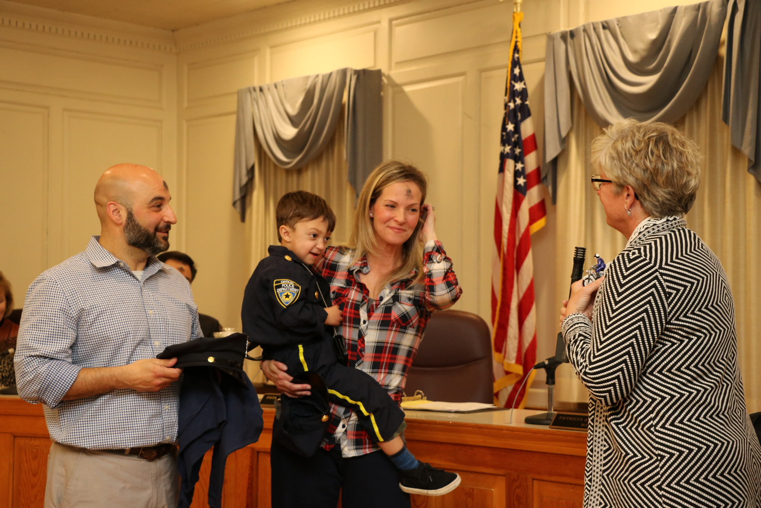 Mayor Patti Ann McDonald presented Malvernite Matteo Ventrudo, 4, with one of her husband's favorite police figurines. Joining them were Ventrudo's parents, Theresa and John Ventrudo.