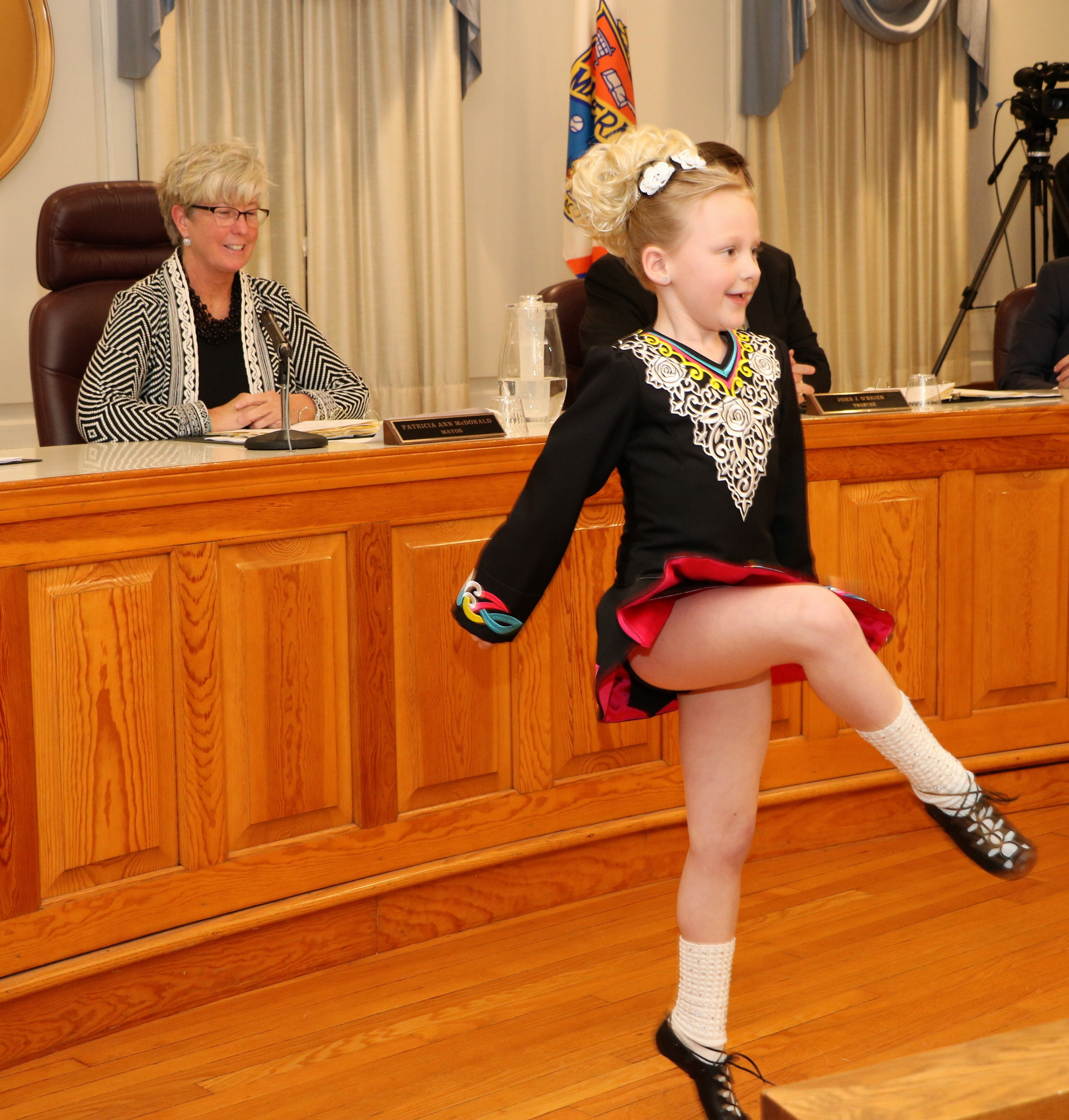 Malverne Mayor Patti Ann McDonald enjoyed an Irish step dance performed by Maeve Ledwith, 7, at the March Village Board meeting.