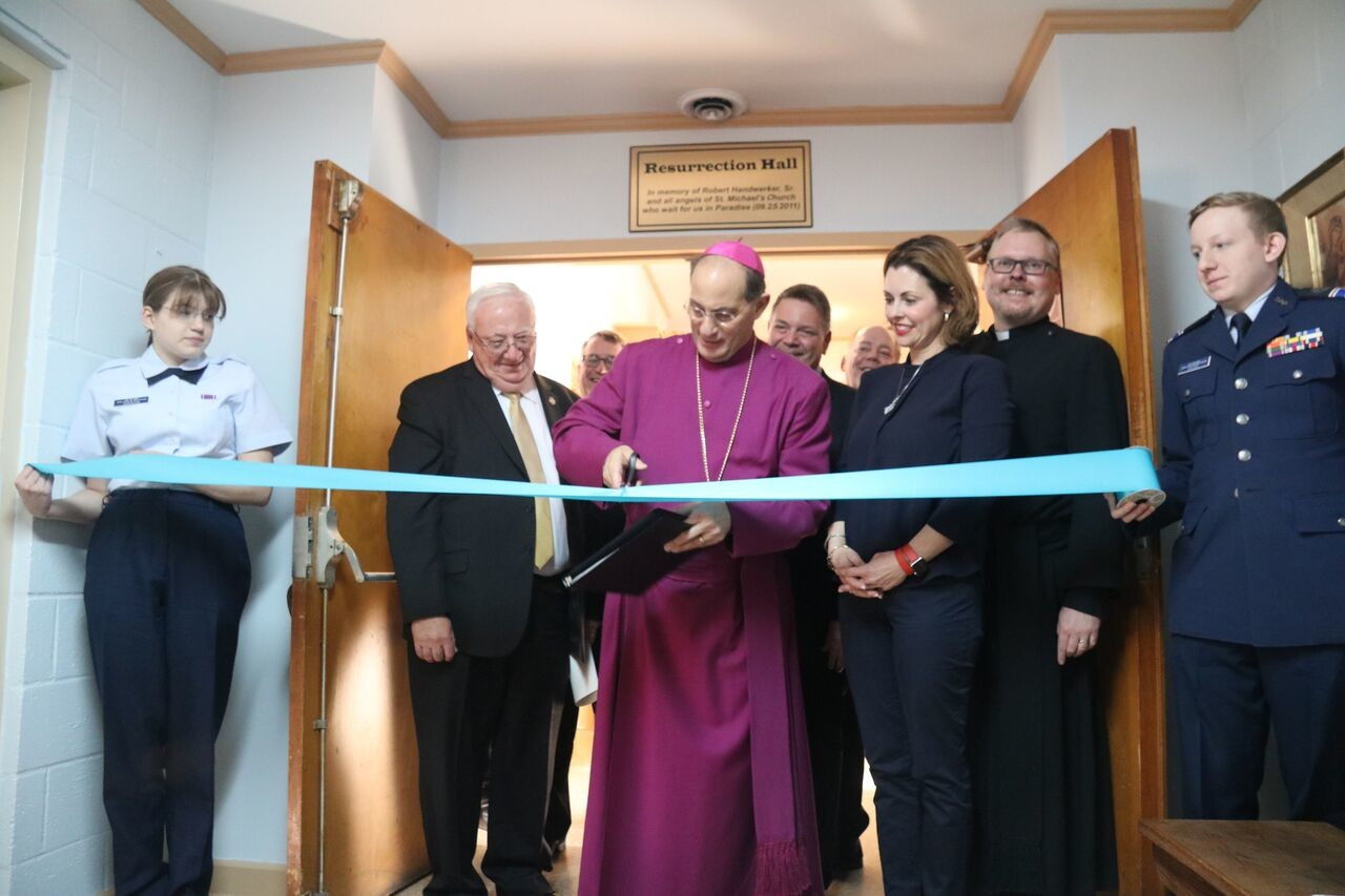 Bishop Lawrence Provenzano, center, locally elected officials and leaders from the Church of St. Jude officially opened the Wantagh house of worship's mission center at St. Michael and All Angels in Seaford on Feb. 26.
