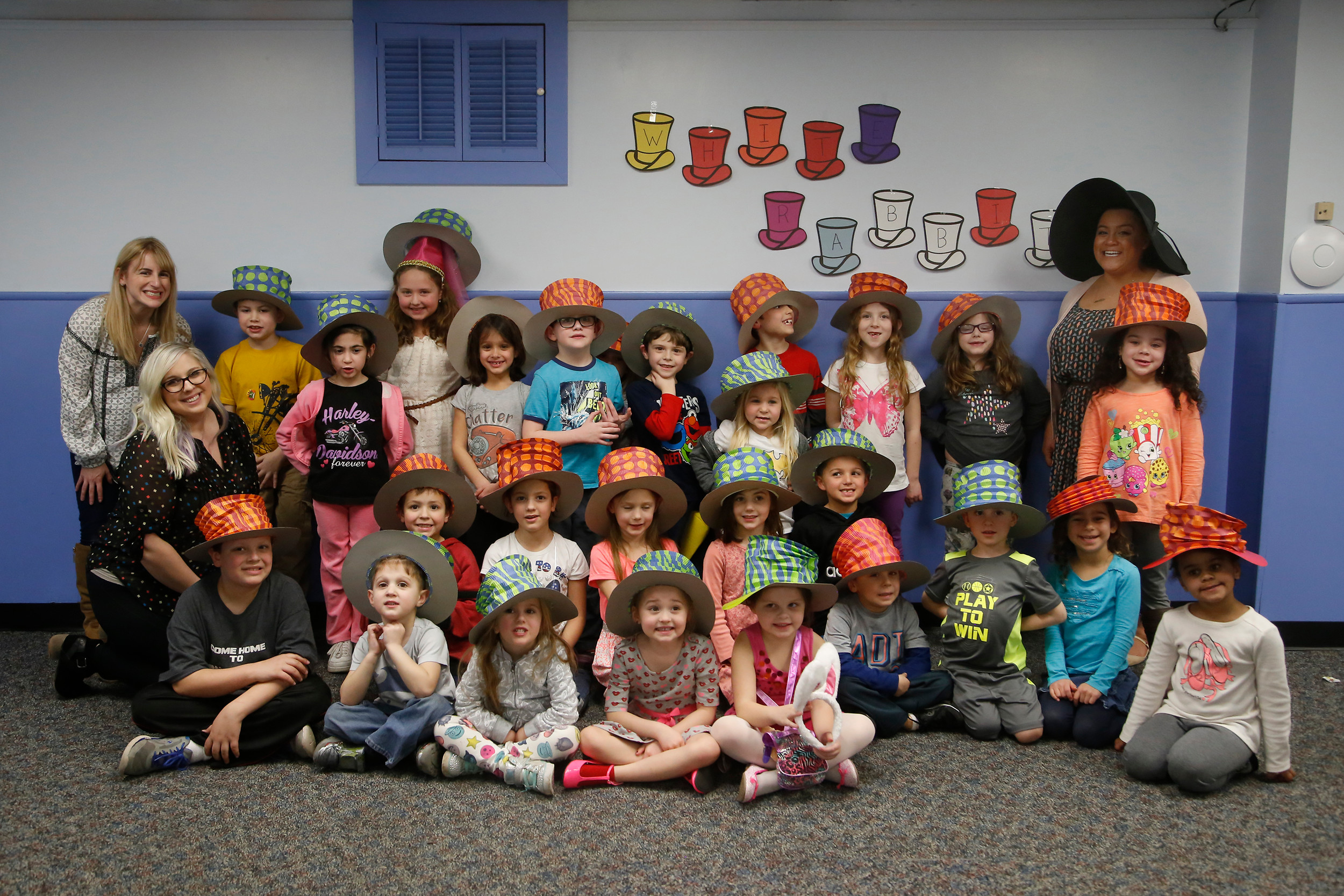 Dozens of youngsters wore wacky hats to the 20th annual Mad Hatter's Tea Party at the Seaford Public Library last month.