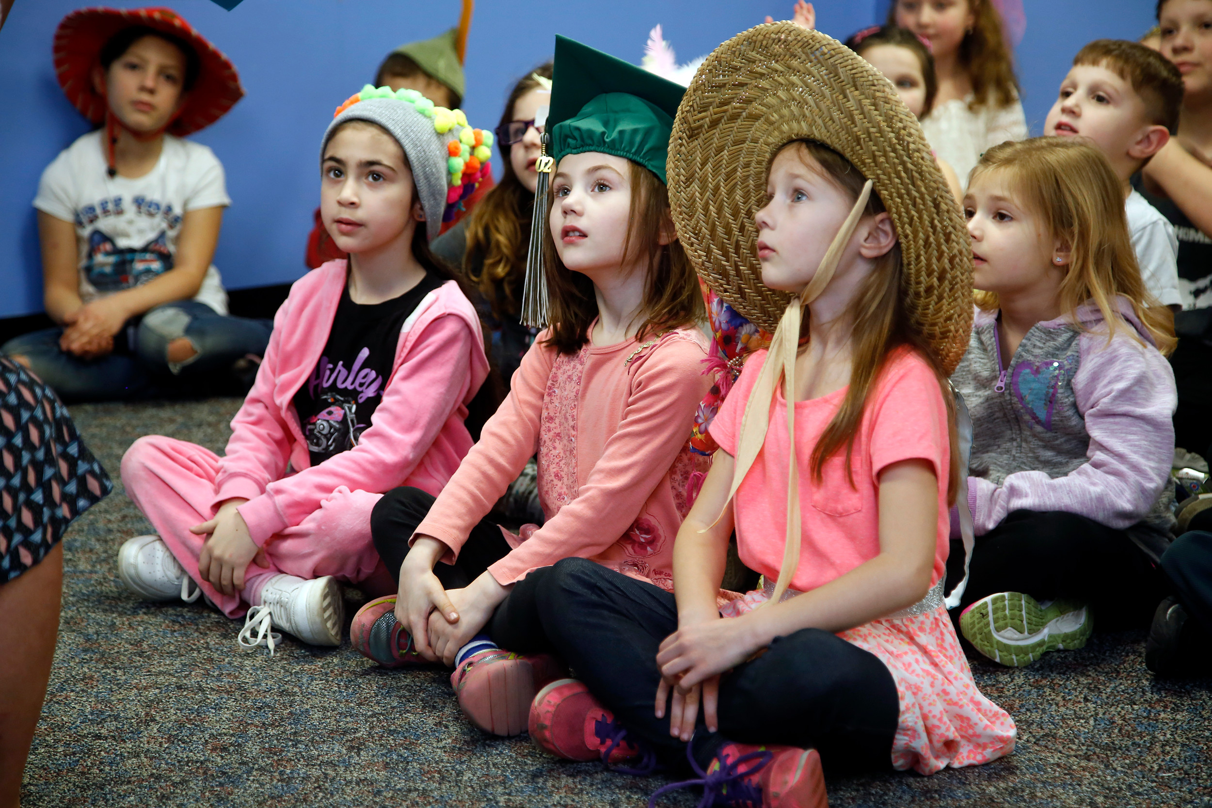 Jaylyn Klun, Jade Mosiello and Ayla Mosiello paid attention during story time.