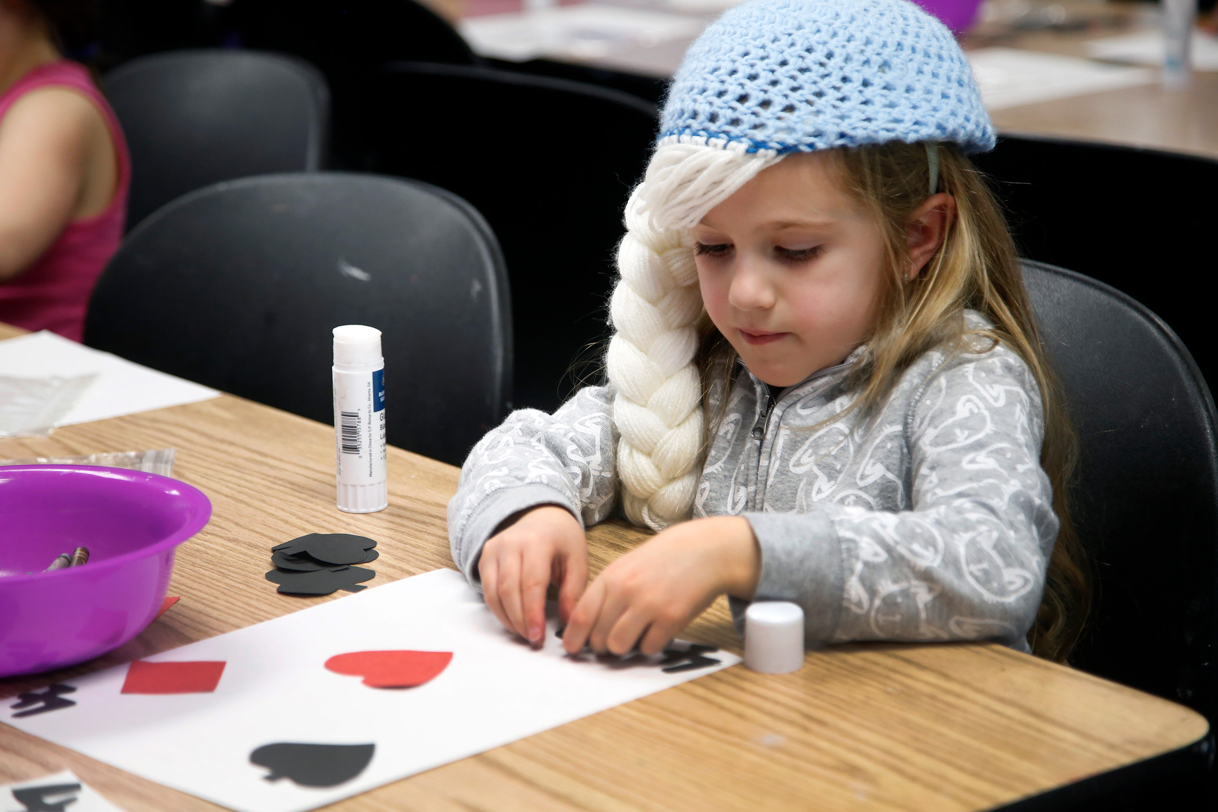 "Jovie Hartmann enjoyed crafting. The youngsters were asked to make ""Alice in Wonderland"" -themed cards and drawings."