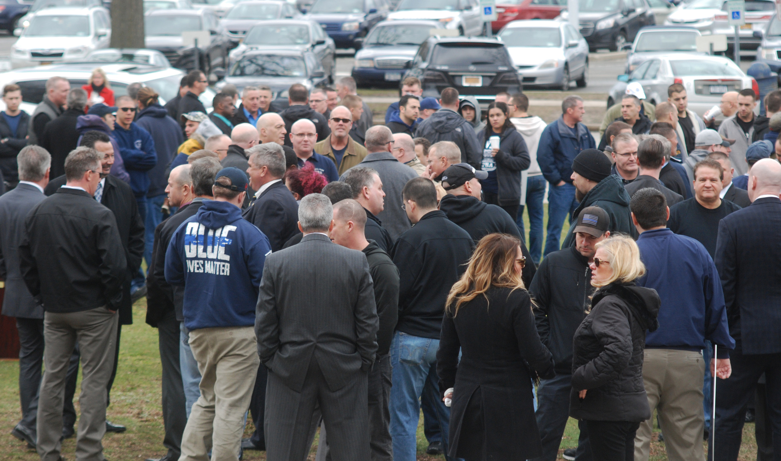 Police officers, firefighters and sanitation worker gathered outside the courthouse early before Federico was led into court around 9:15 a.m.