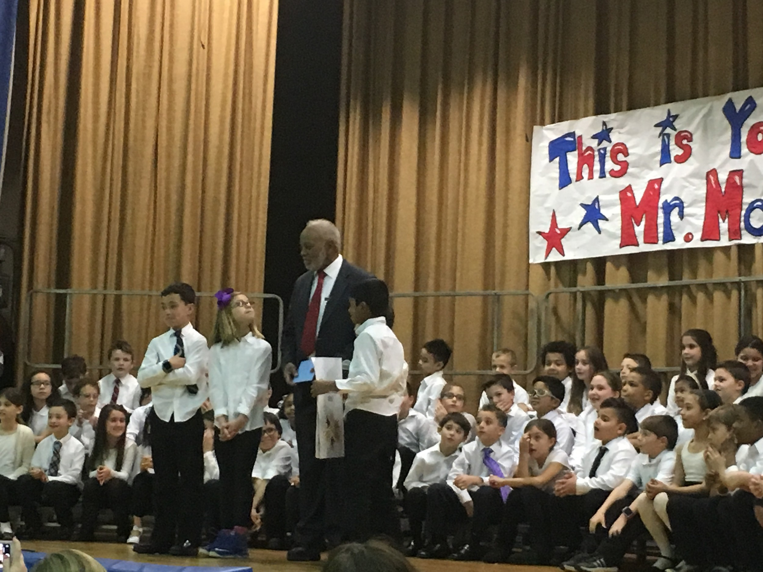 Third-grade students from Marion Street presented Joseph McNeil with a birthday card for his 75th birthday, which is on March 25.